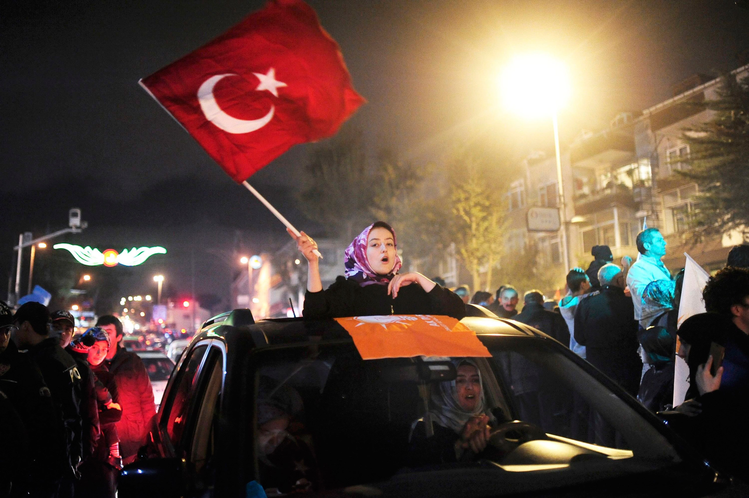 Supporters of the Justice and Development Party (AKP) gather near the residence of Turkish President Recep Tayyip Erdogan to celebrate their party's election victory in Istanbul on Nov. 1, 2015.