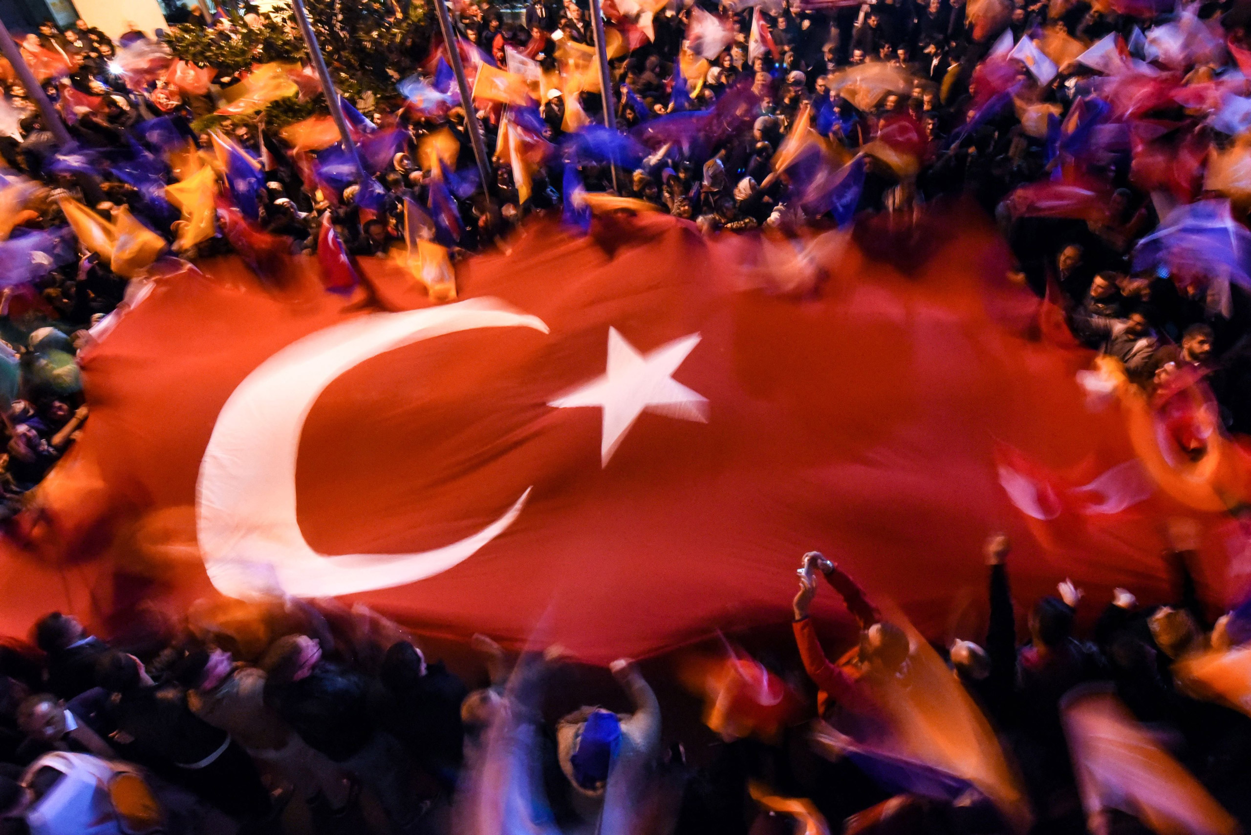Supporters of Turkey's Justice and Development Party (AKP) wave a giant Turkish flag as they celebrate after the first results in the country's general election in Istanbul on Nov. 1, 2015.