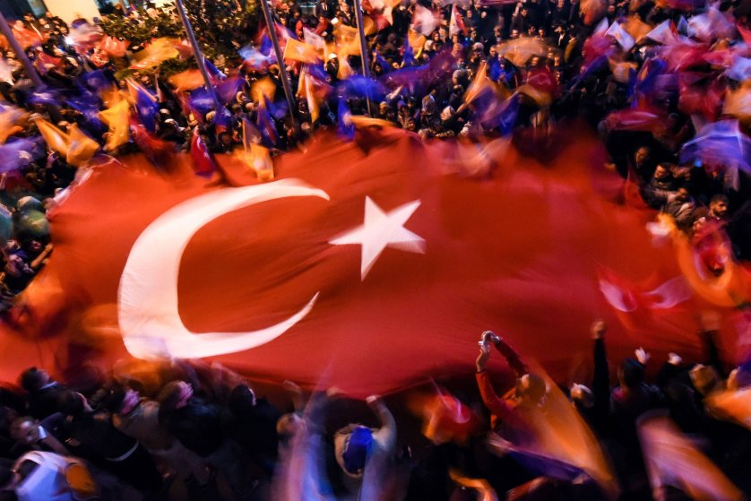 Supporters of Turkey's Justice and Development Party (AKP) wave a giant Turkish flag as they celebrate in Istanbul after the first results in the country's general election on November 1, 2015. Turkey's long-dominant Justice and Development Party (AKP) scored a stunning electoral comeback, regaining its parliamentary majority in a poll seen as crucial for the future of the troubled country. AFP PHOTO / OZAN KOSEOZAN KOSE/AFP/Getty Images