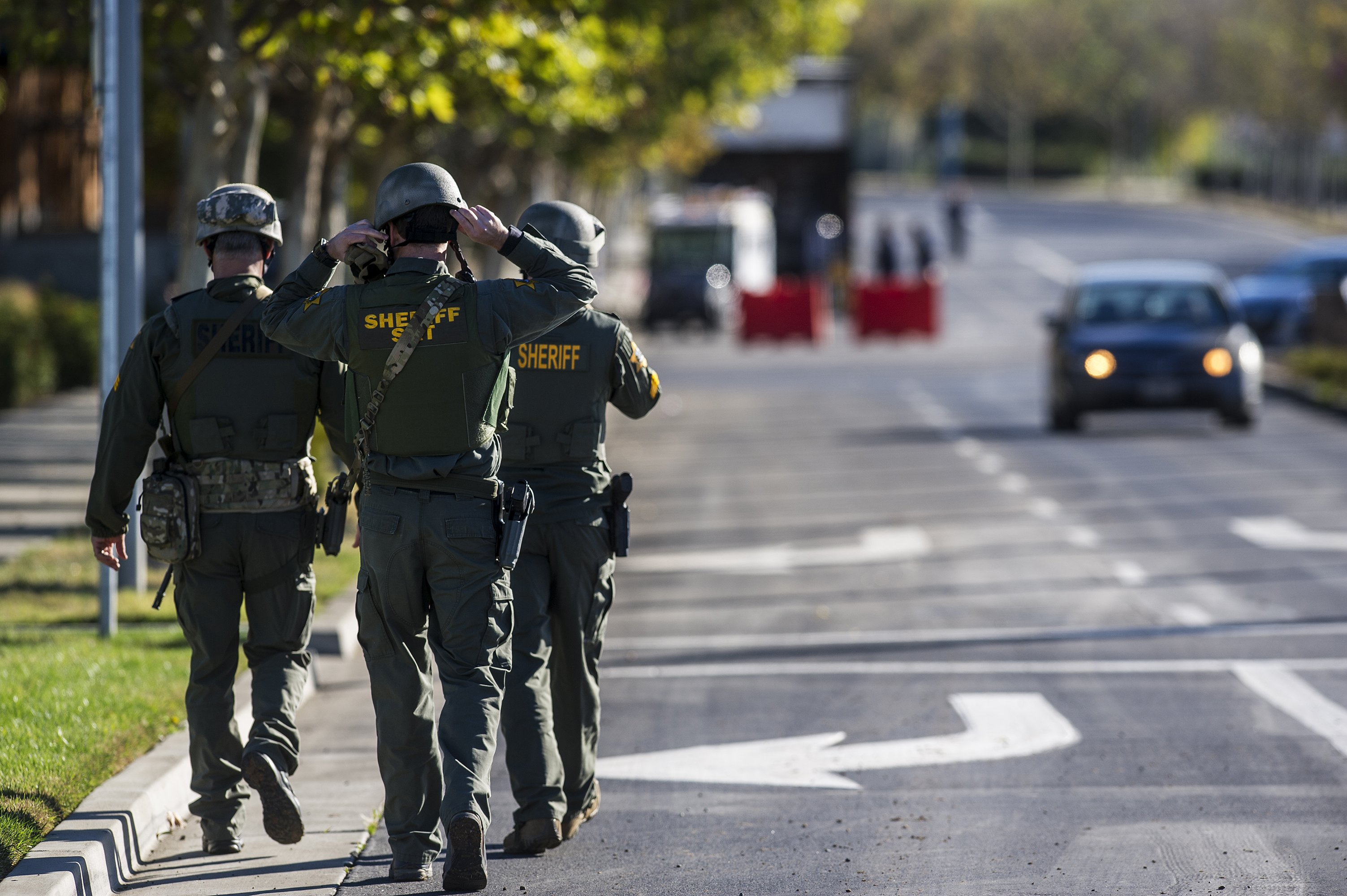 Merced County Sheriff SWAT members enter the University of California, Merced campus after a reported stabbing in Merced, Calif. on Nov. 4, 2015.