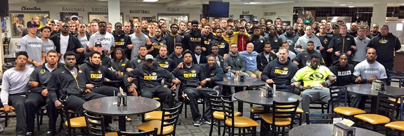 A photo tweeted by Missouri football coach Gary Pinkel on Nov. 8, 2015 shows the University of Missouri football players locked arm in arm in Columbia, Mo.