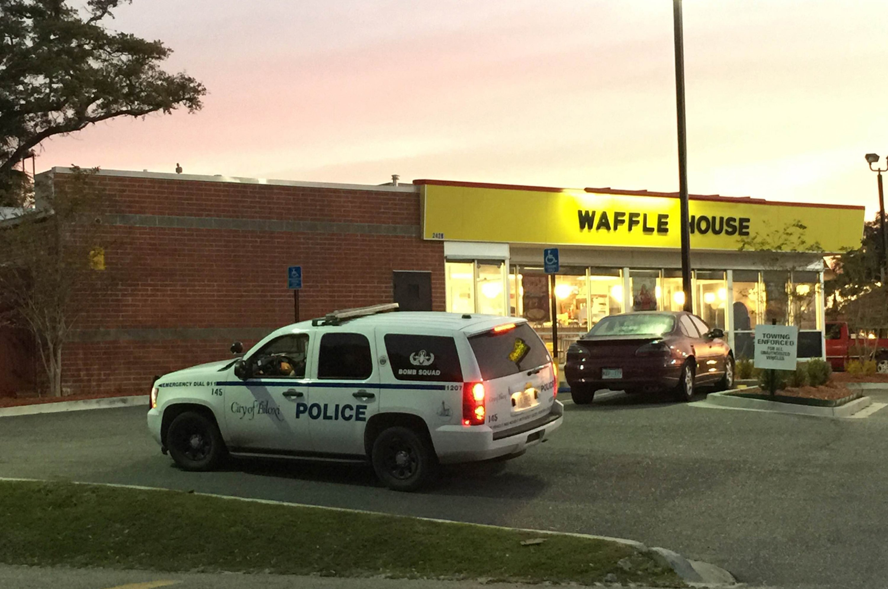 A police vehicle sits outside the Waffle House on U.S. 90 in Biloxi, Miss., after a fatal shooting on Nov. 27, 2015.