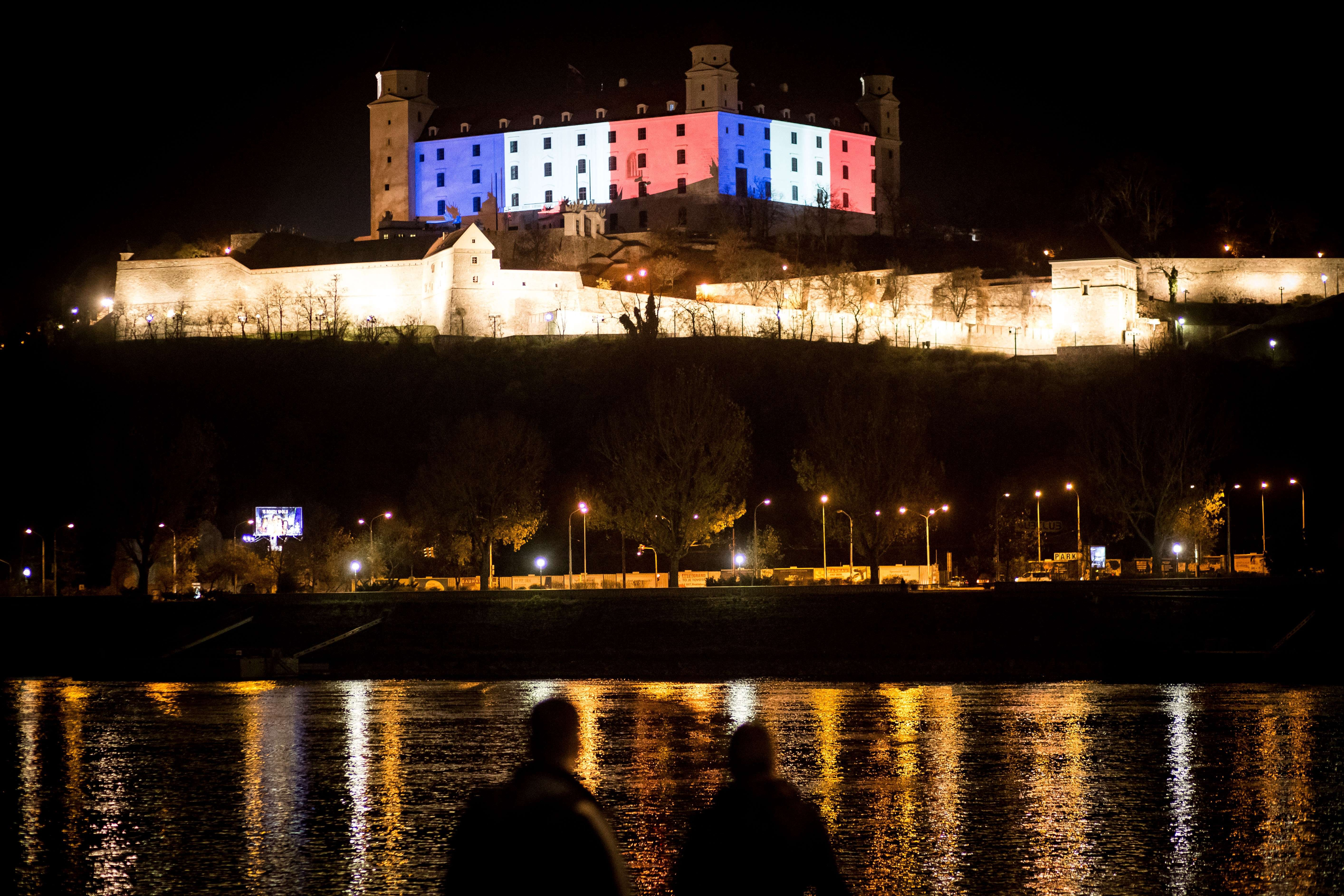 Bratislava Castle is lit in red, white and blue, the colors of the French flag, in Bratislava, Slovakia on Nov. 14, 2015.
