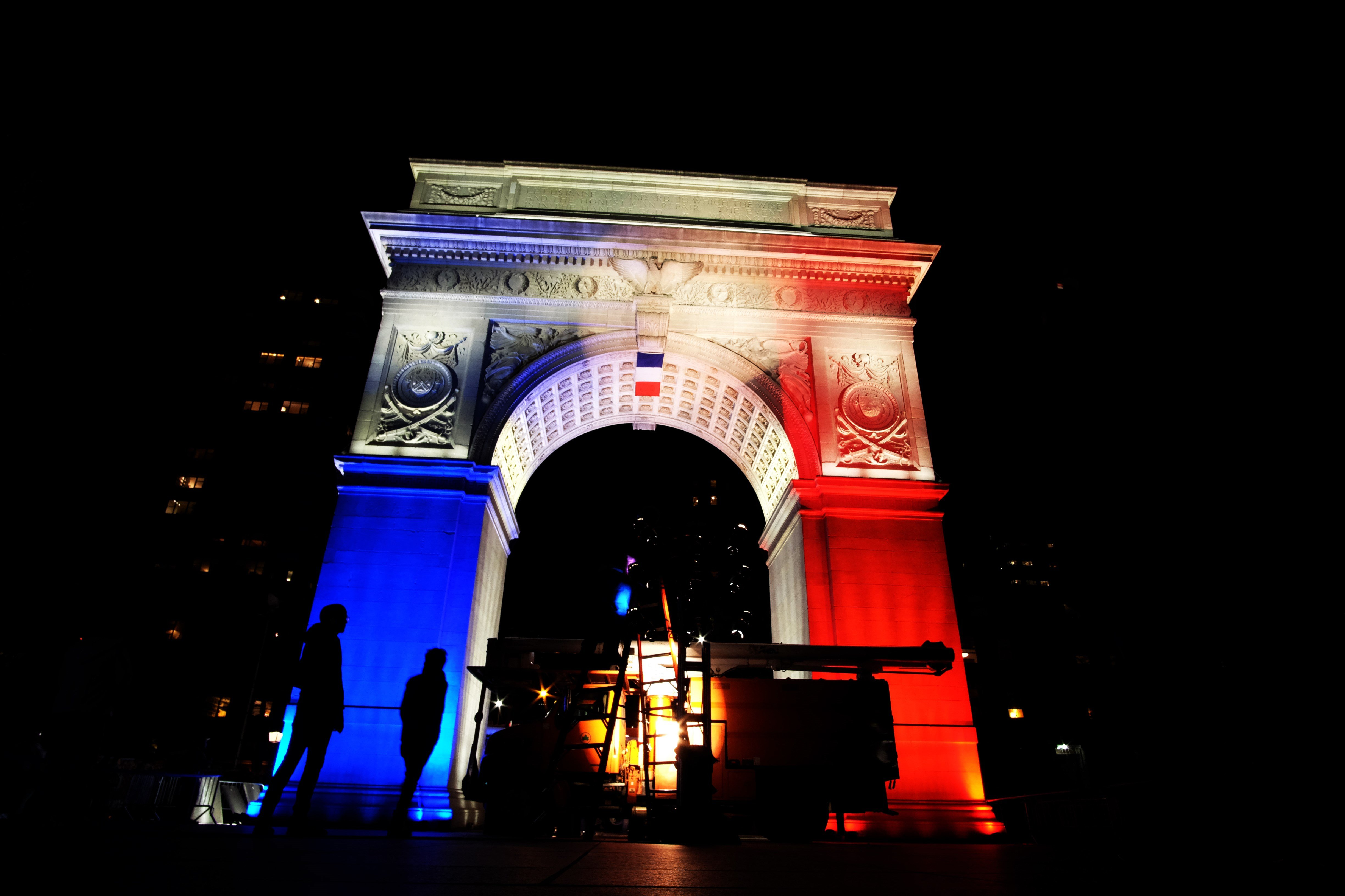The Washington Square Park arch in New York City is lit with the French national colors in solidarity with the citizens of France on Nov. 14, 2015.