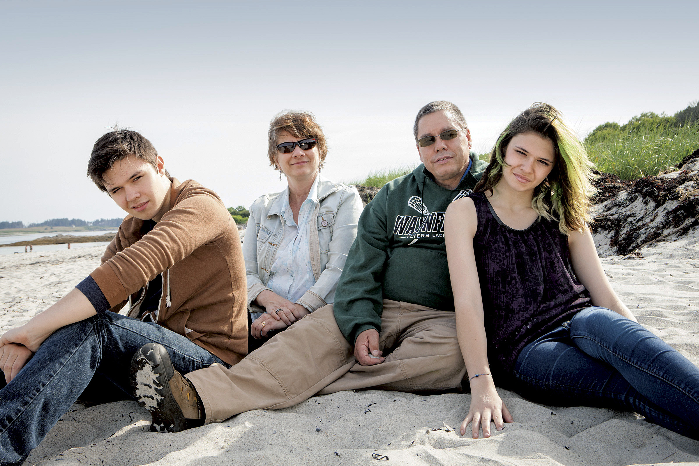 In this summer 2015 photo released by Random House, twins Jonas, left, and Nicole Maines, right, pose with their parents Kelly, second from left, and Wayne Maines, second from right at Crescent Beach State Park in Cape Elizabeth, Maine.
