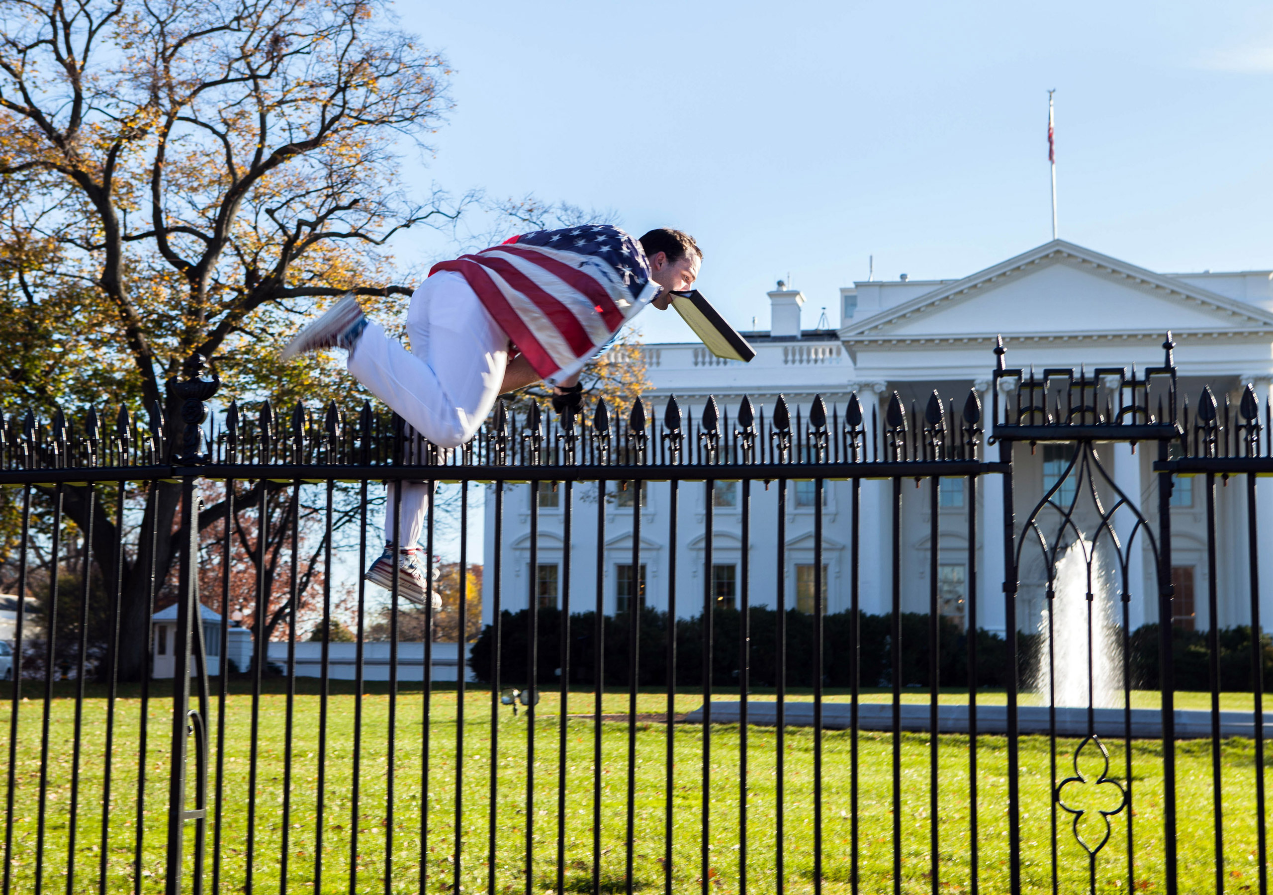A man jumps a fence at the White House in Washington on Nov. 26, 2015.