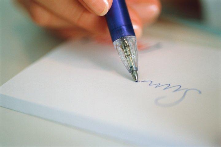 woman-hand-writing-pen