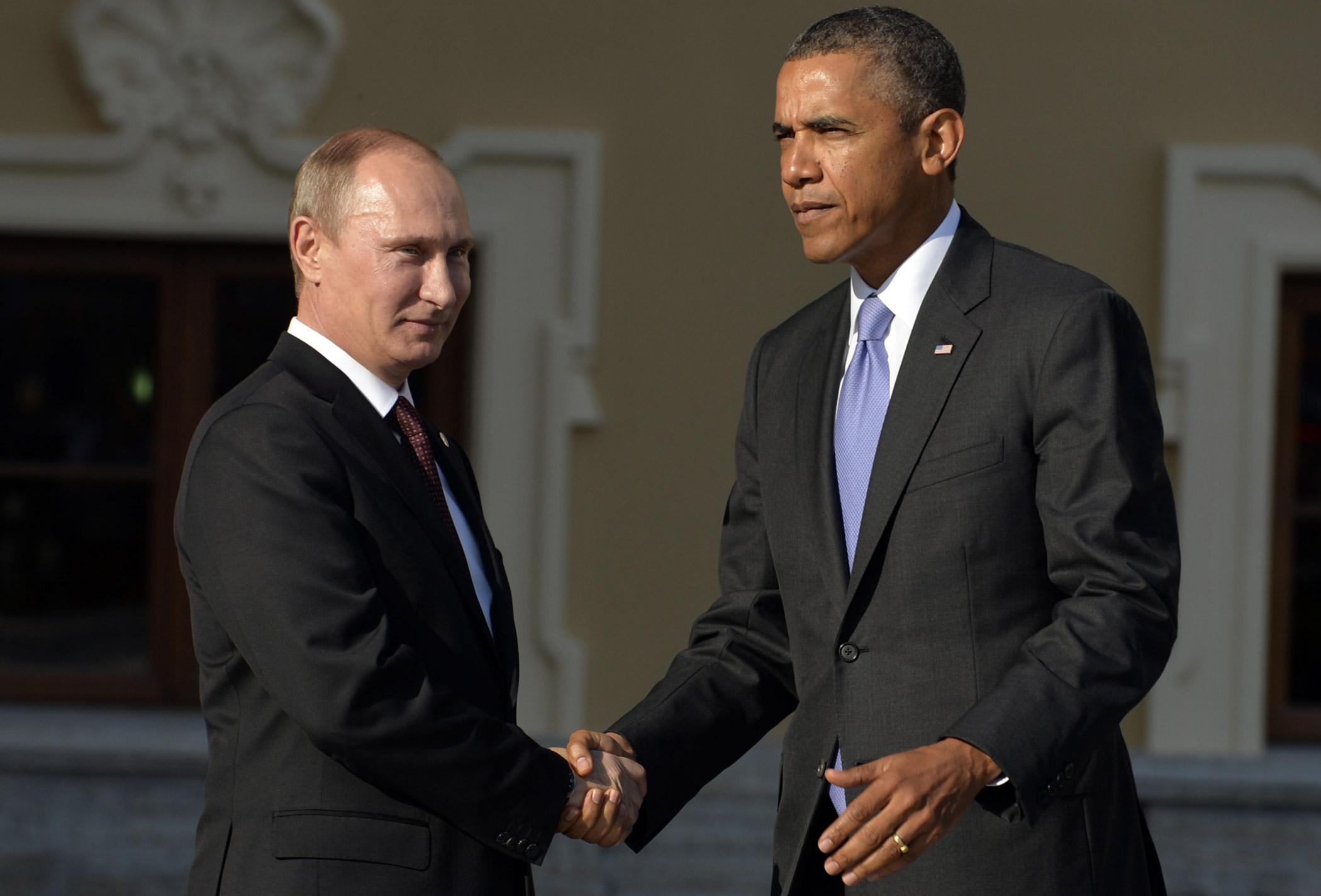 Russian President Vladimir Putin and U.S. President Barack Obama shake hands at the G20 summit in Saint Petersburg on Sept. 5, 2013.