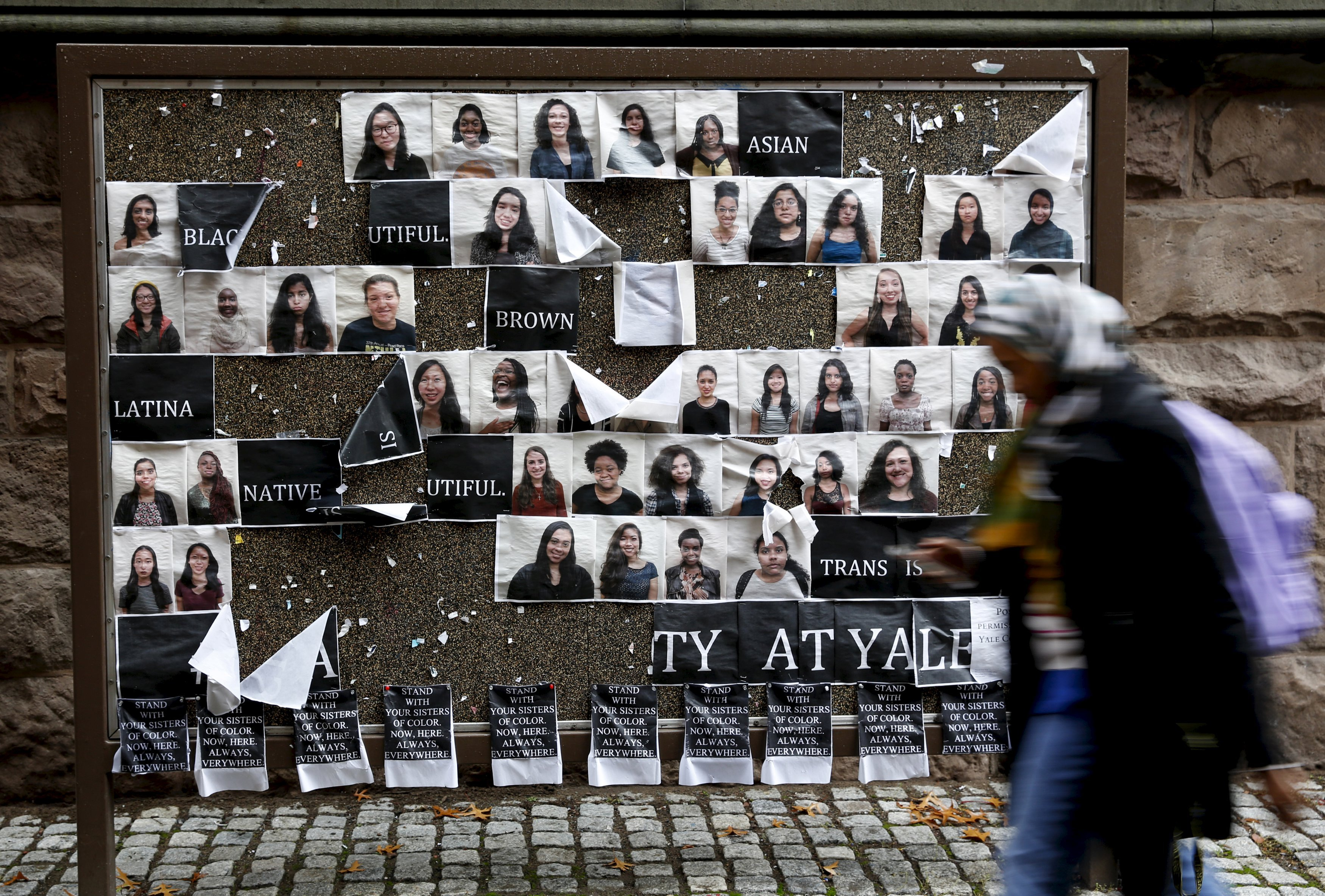 A student walks by a college noticeboard on campus at Yale University in New Haven, Connecticut on Nov. 12, 2015.