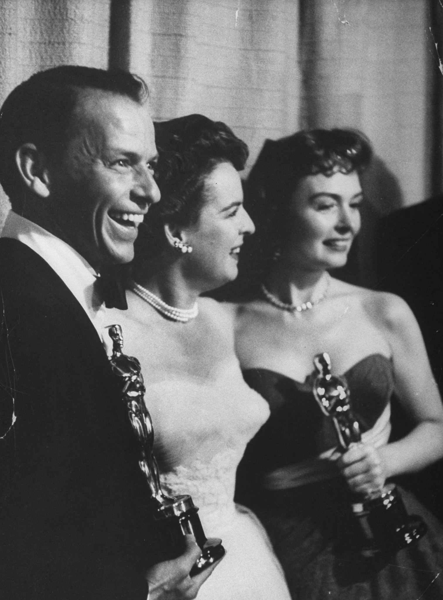 "Sinatra and Donna Reed (R) holding Oscars received for their performances in ""From Here to Eternity,"" with presenter Mercedes McCambridge at the 26th Annual Academy Awards Ceremony, 1954."