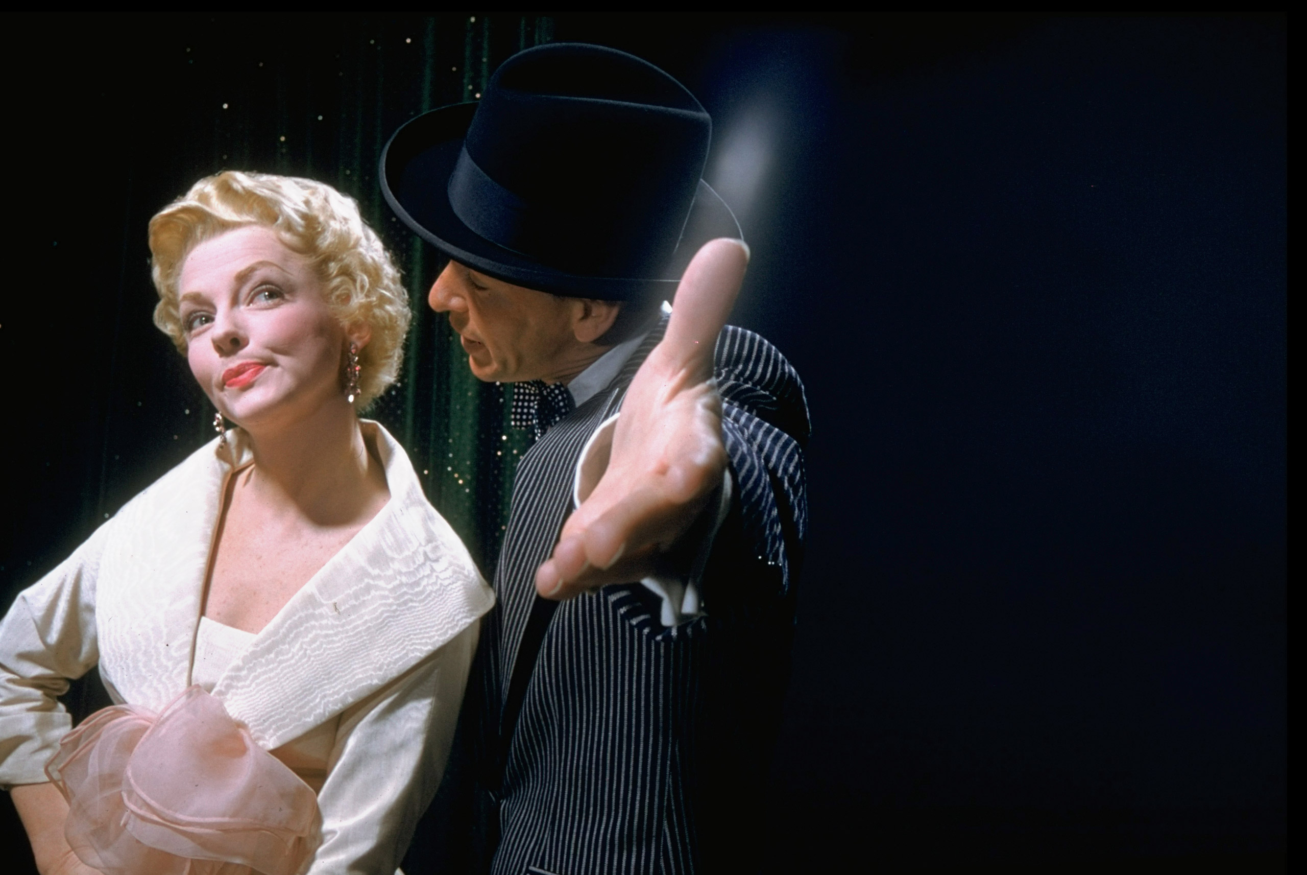 "Sinatra singing to Vivian Blaine in a scene from the film ""Guys and Dolls,"" 1955."