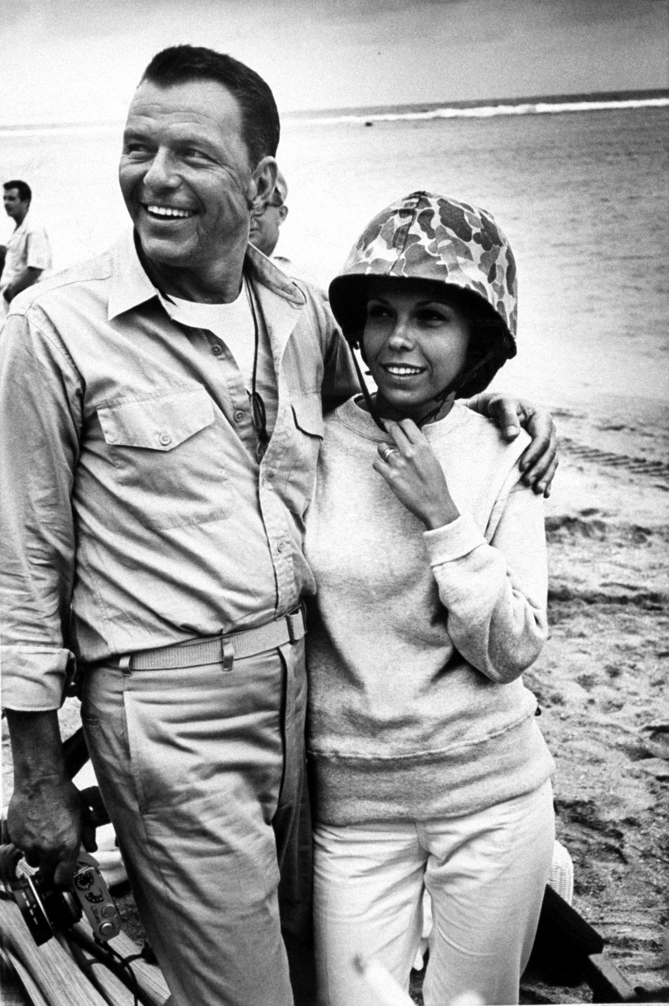 "Nancy Sinatra with her father, Frank Sinatra, during the production of ""None But The Brave,"" 1964."