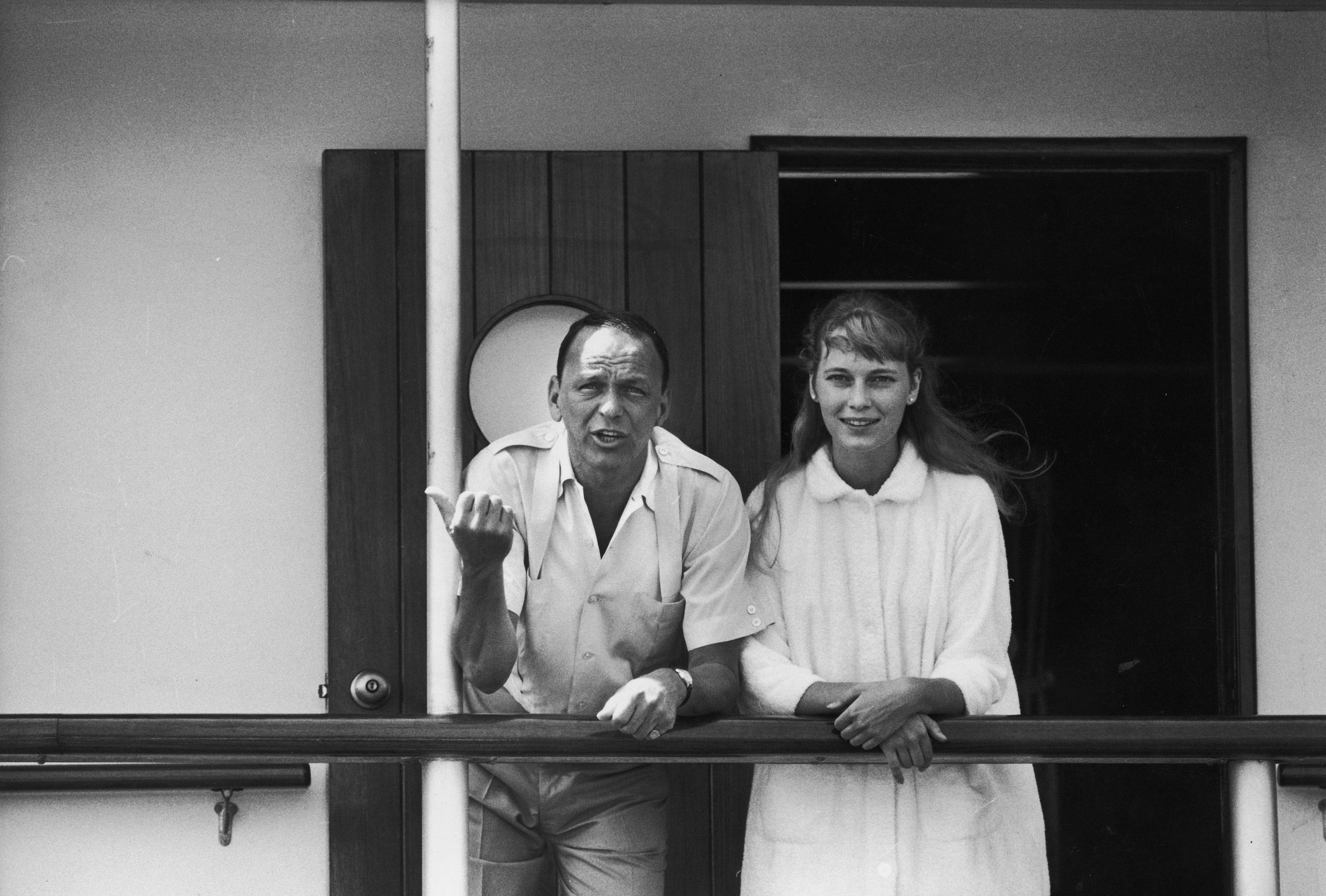Frank Sinatra with  girlfriend Mia Farrow on the deck of the yacht Southern Breeze, 1965.