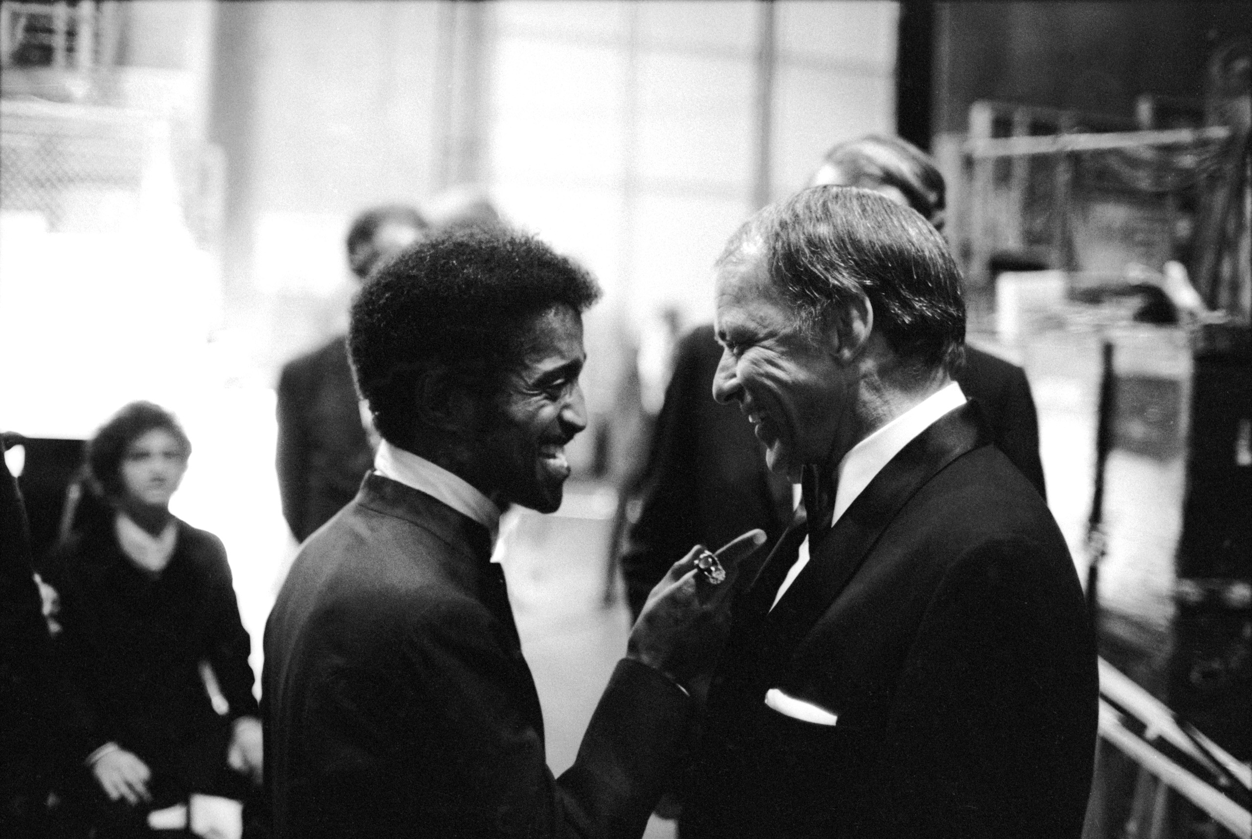 Sammy Davis Jr. talking with Sinatra at Sinatra's farewell performance, at UCLA, 1971.