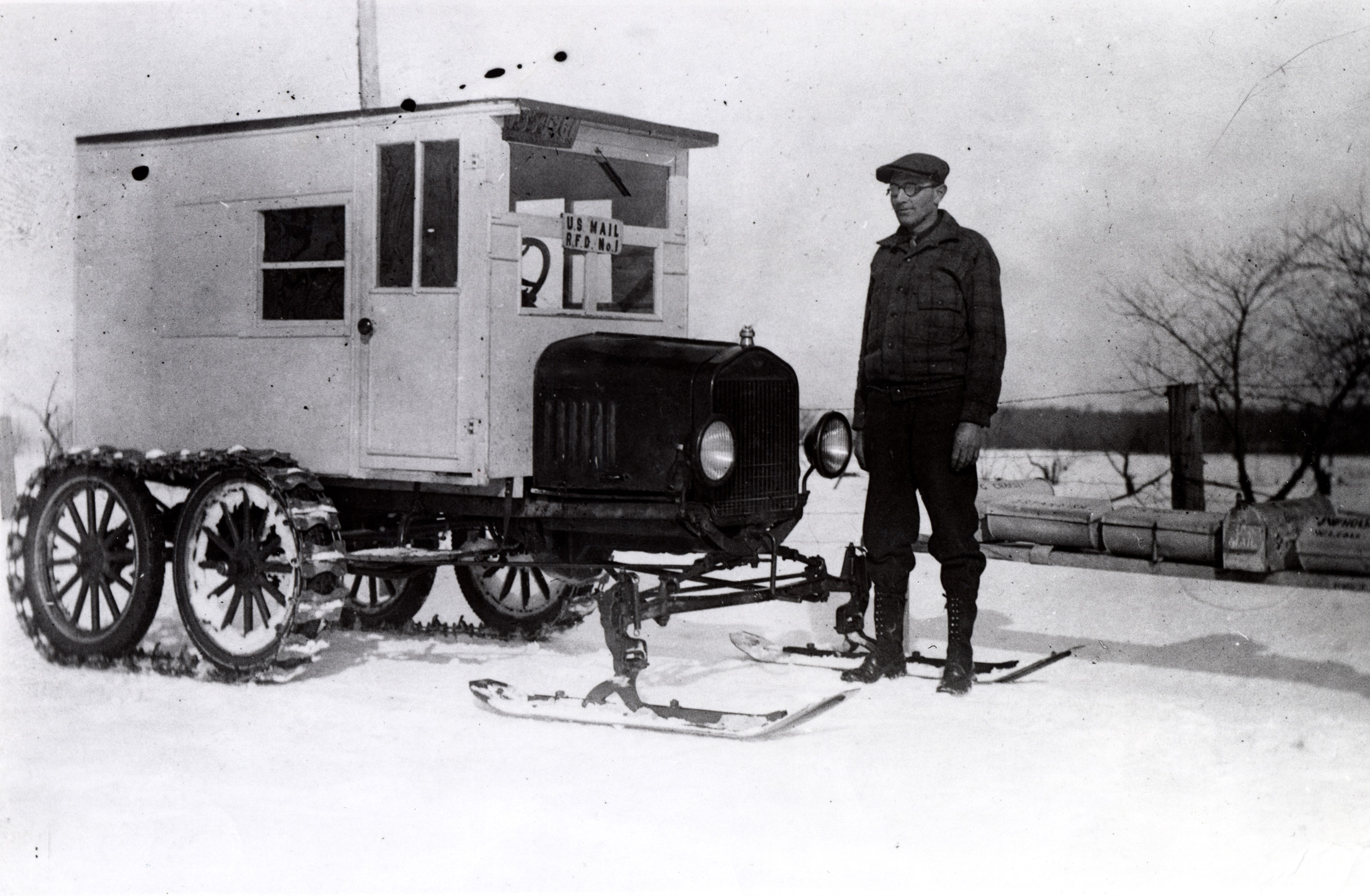 Rural carrier Lloyd Mortice created this unusual vehicle for use on his snow-bound New England route. Mortice fitted his 1926 Model-T with a steel track on the rear drive shaft, enabling him to drop either wheels or skis into place in front, depending on weather conditions.