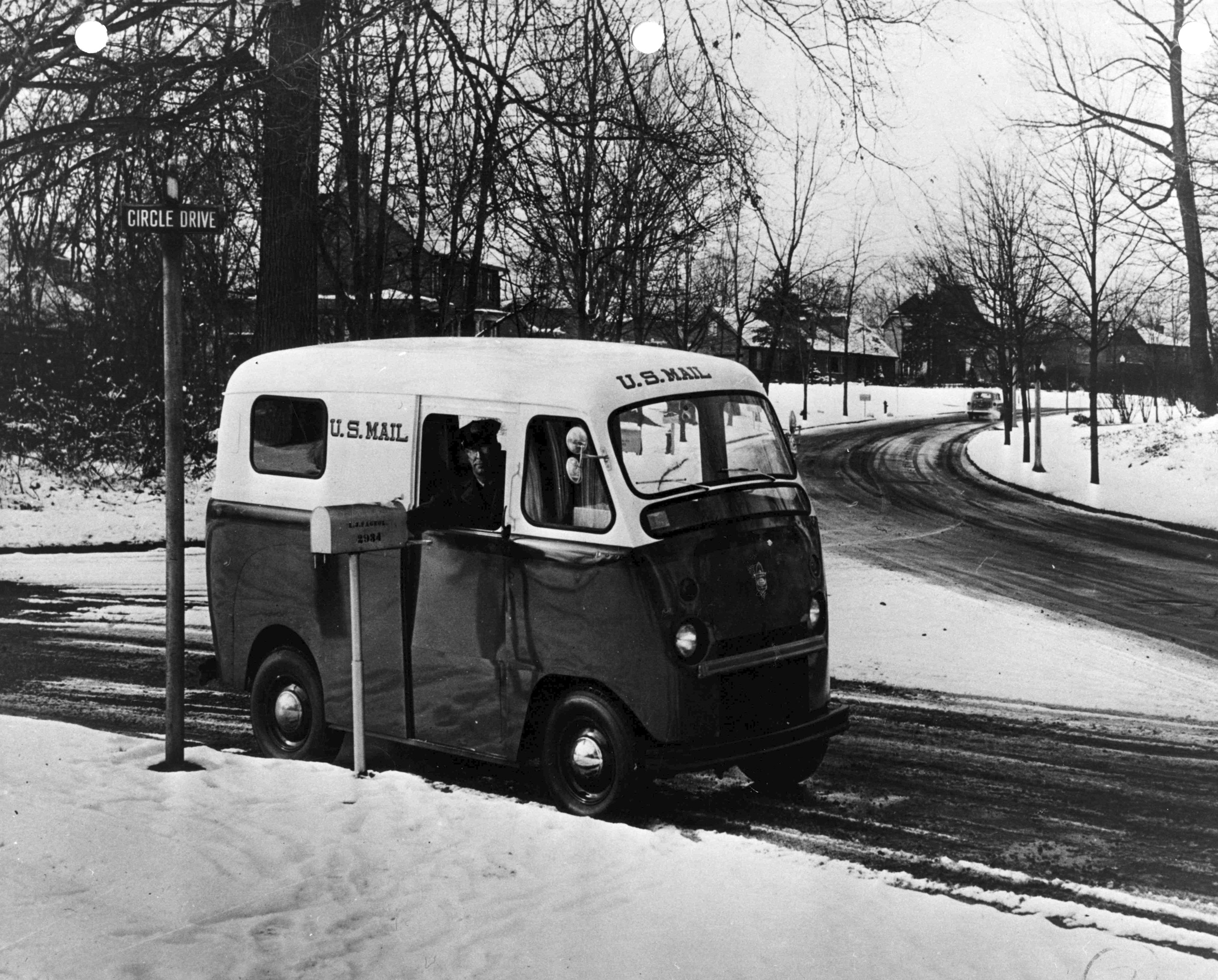 In 1953, a letter carrier drives one of the Department's new right-hand drive vans on the snowy streets of an unidentified city. The Department ordered thousands of new postal vehicles in the early 1950s as part of its post-war modernization plan. Few of the dozens of different vehicles ordered during that drive were re-ordered in large quantities.