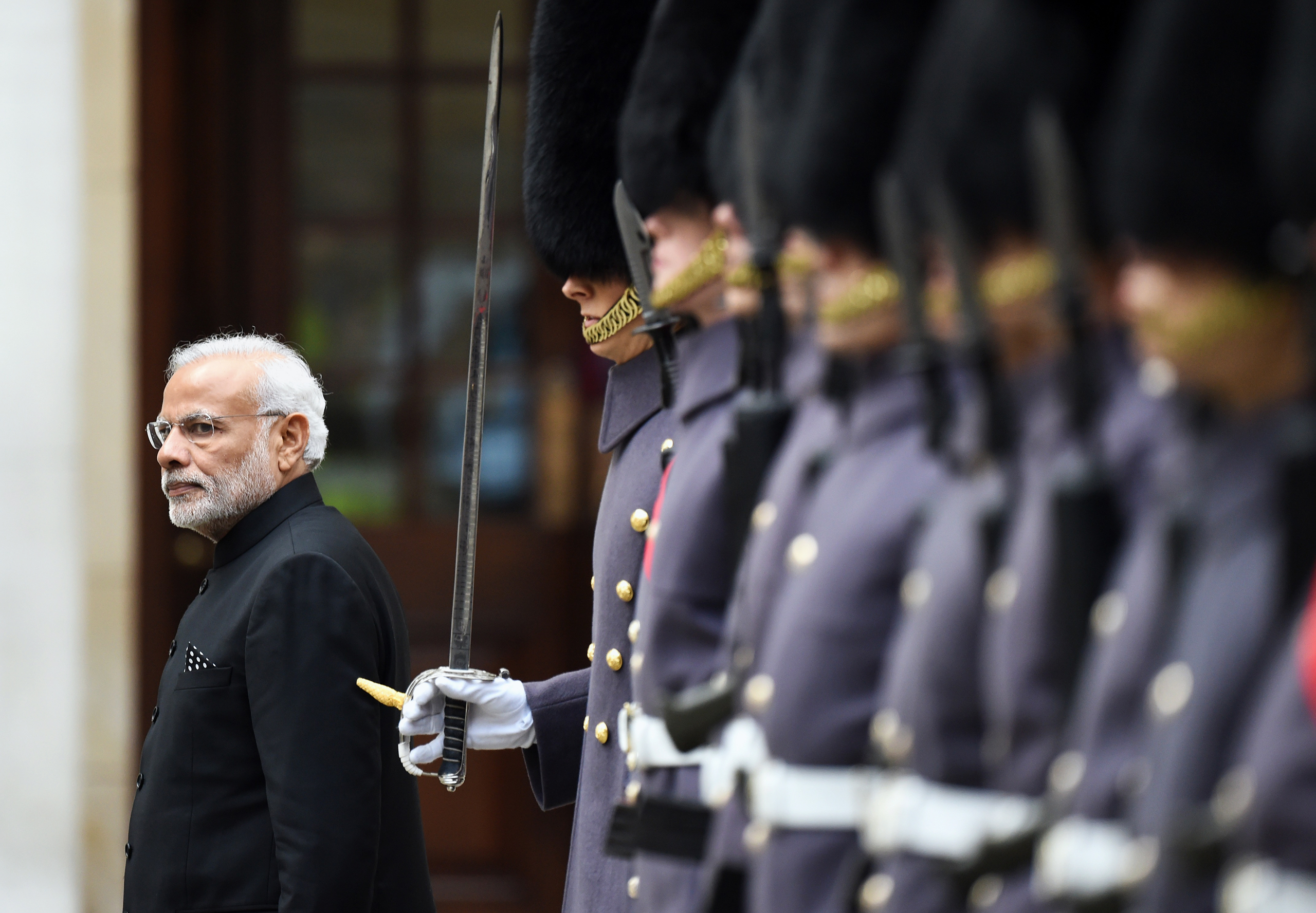 Modi inspects a Guard of Honor in London on Nov.12, one of his more than 30 foreign trips so far