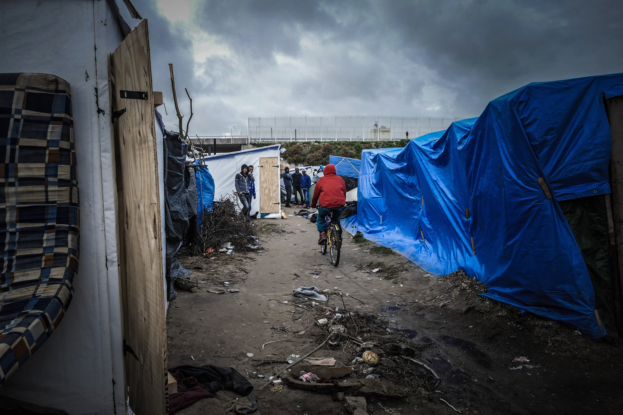 Some 6,000 migrants and refugees have sought shelter in the Jungle, an unofficial camp in the French port city of Calais.