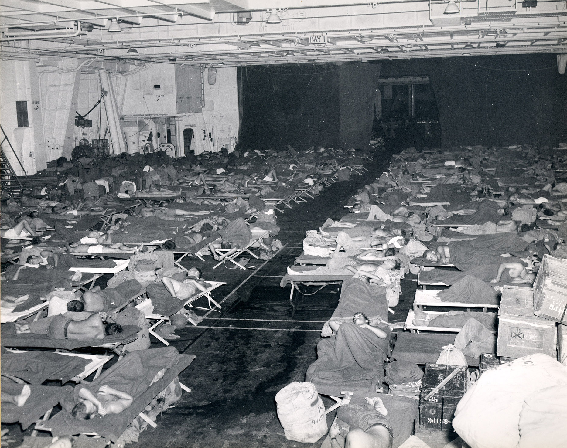 Personnel being transported back to the States on board Intrepid (CV 11) during Operation Magic Carpet. This image is part of a photograph album detailing the wartime service of the carrier Intrepid (CV 11) in the Pacific during World War II.