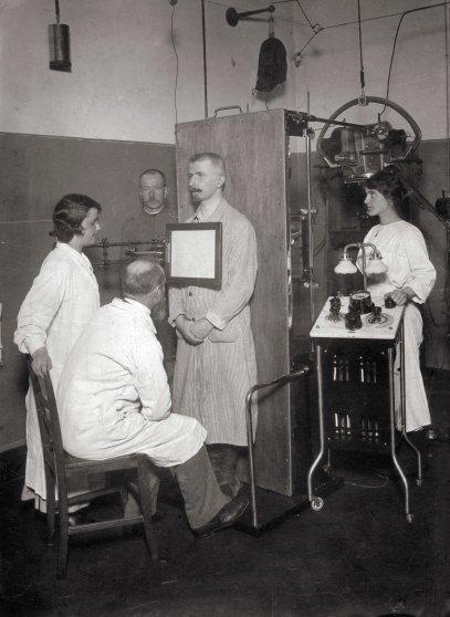 A man receiving an x-ray in Austria, circa 1910.