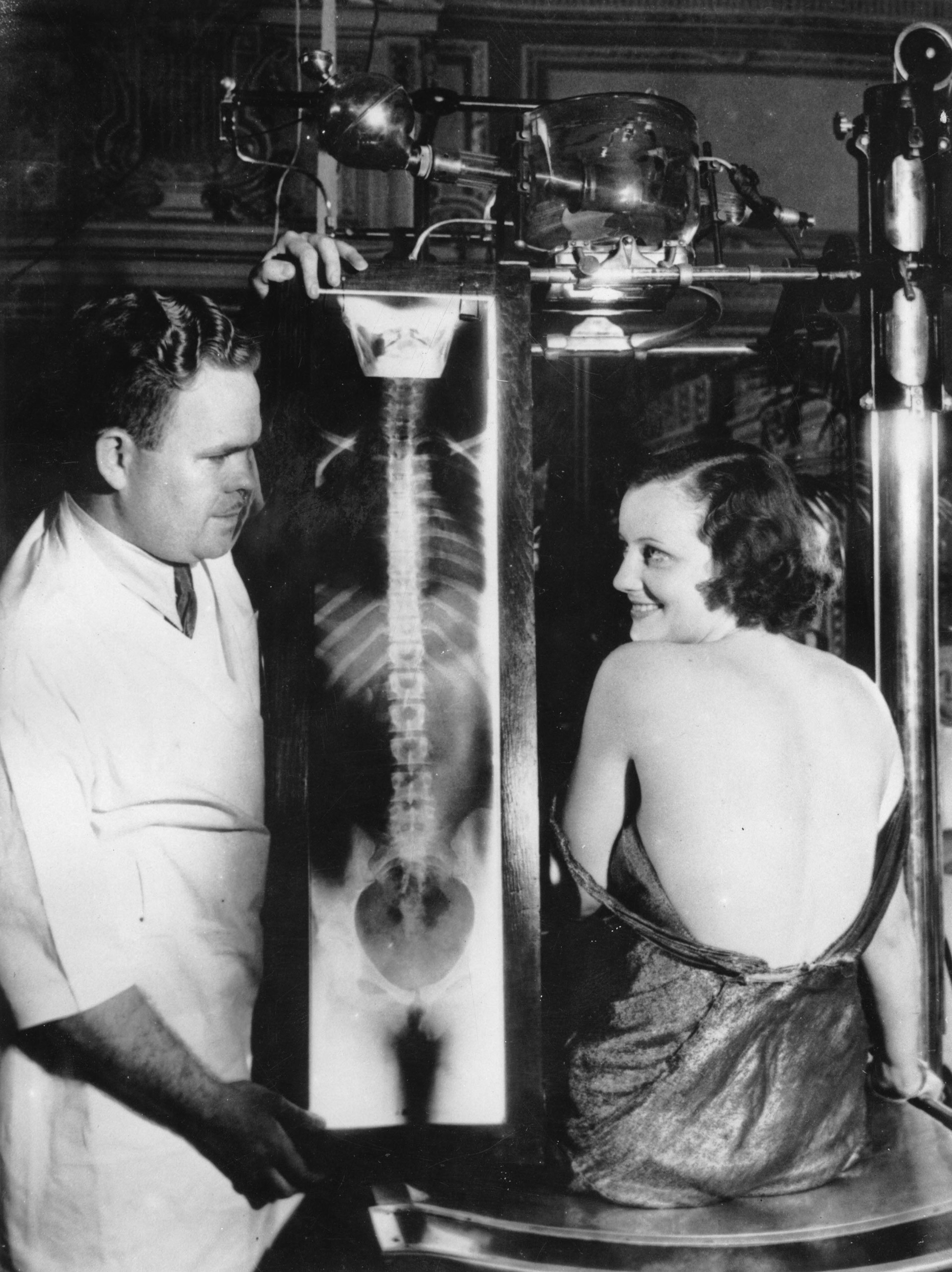 Filmstar Judith Allen with the radiograph of her back, circa 1930.