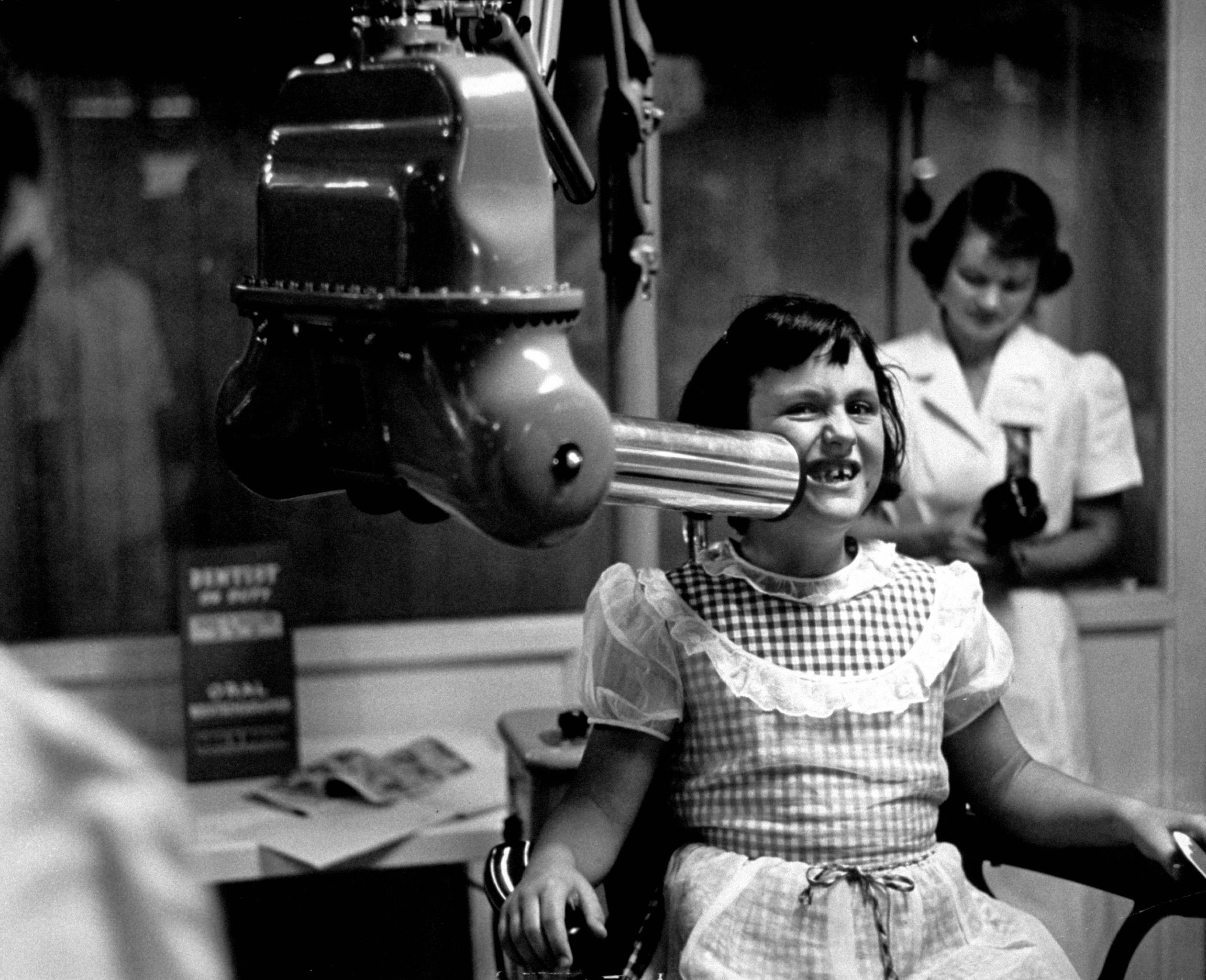 X-ray machine, at the California dental association exhibit, California state fair, 1953.