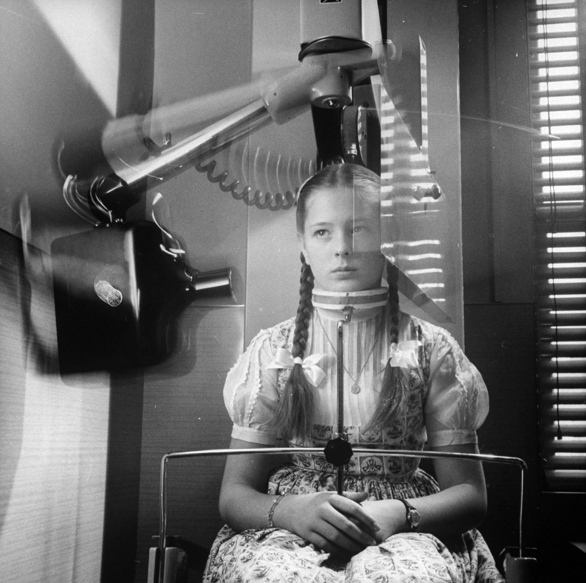 X-ray machine which circles head to take panoramic picture of teeth, eliminating usual mouthful of film, 1960.