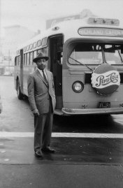 American Civil Rights leader Reverend Martin Luther King Jr. stands in front of a bus at the end of the Montgomery bus boycott, Montgomery, Alabama, December 26, 1956.