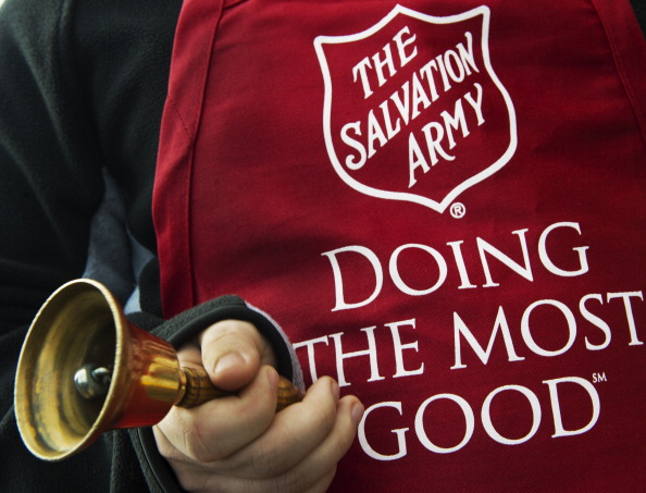 Salvation Army volunteer Bubba Wellens rings the collection bell outside a Giant grocery store November 24, 2012, in Clifton, Virgina. Salvation Army volunteers traditionally are seen collecting donations from holiday shopper for the needy between Thanksgiving and Christmas.             AFP Photo/Paul J. Richards          (Photo credit should read PAUL J. RICHARDS/AFP/Getty Images)