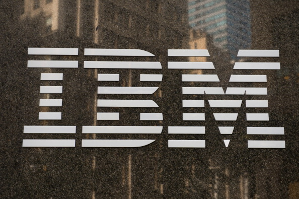 The International Business Machines Corp. (IBM) logo is displayed in front of the company's offices in New York, U.S., on Oct. 14, 2013