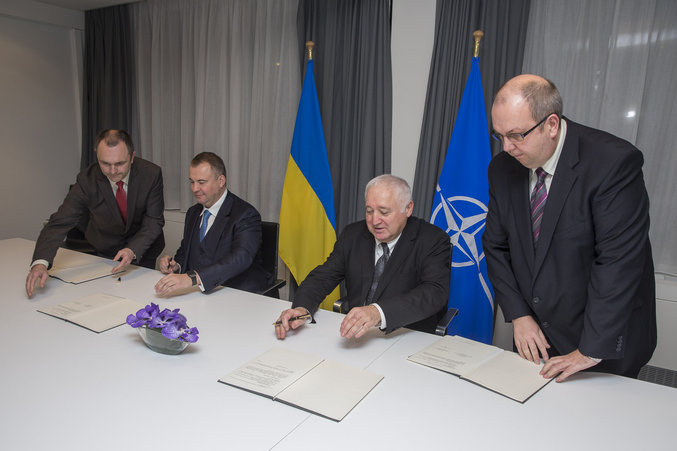 Patrick Auroy, NATO assistant secretary general for defense investment, and Oleg Gladkovski, first deputy secretary of the National Security and Defense Council of Ukraine, signing the road map on Dec. 16, 2015
