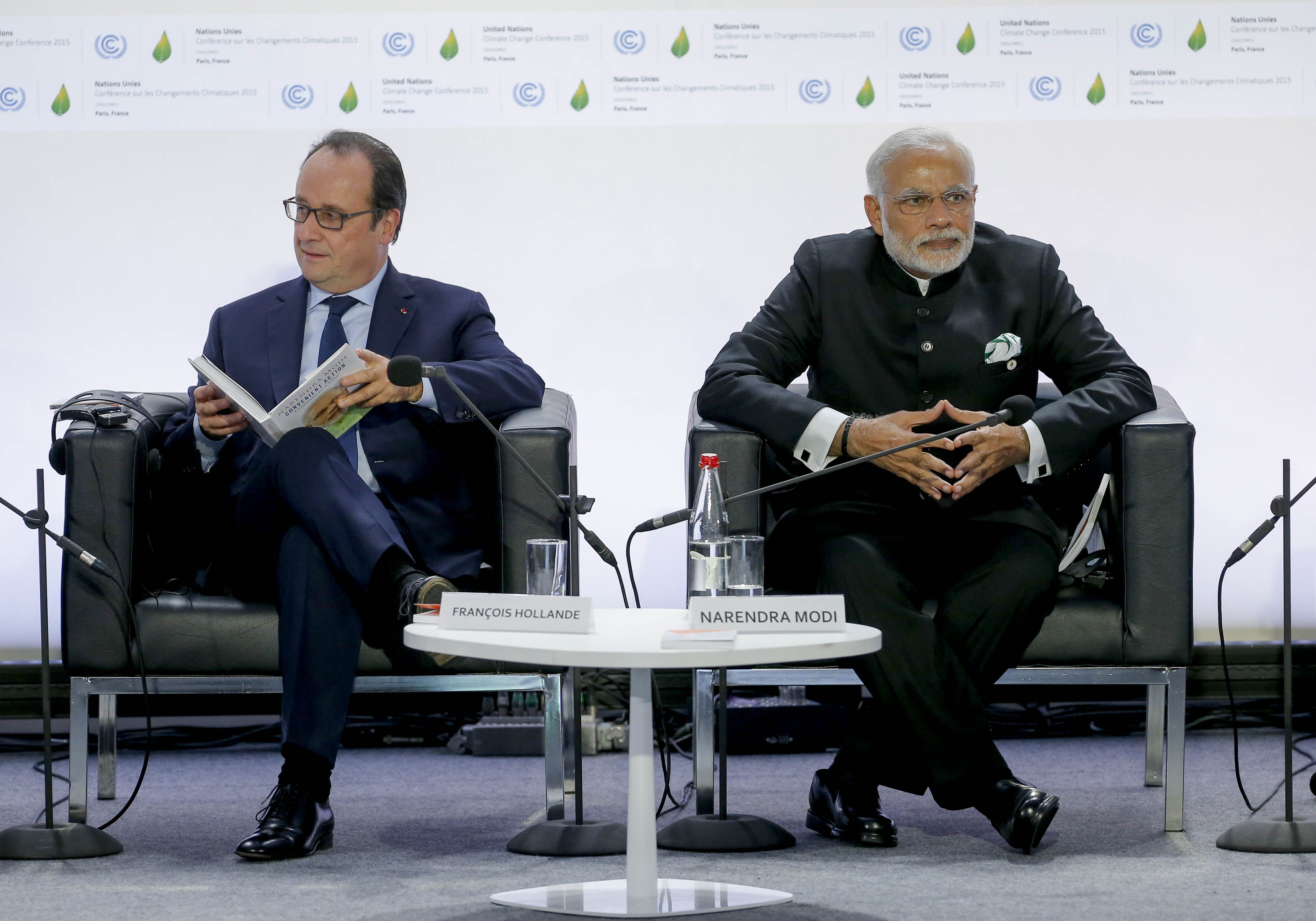 Francois Hollande and Narendra Modi during the 2015 United Nations Climate Change Conference at Le Bourget in Paris, France on Nov. 30, 2015.