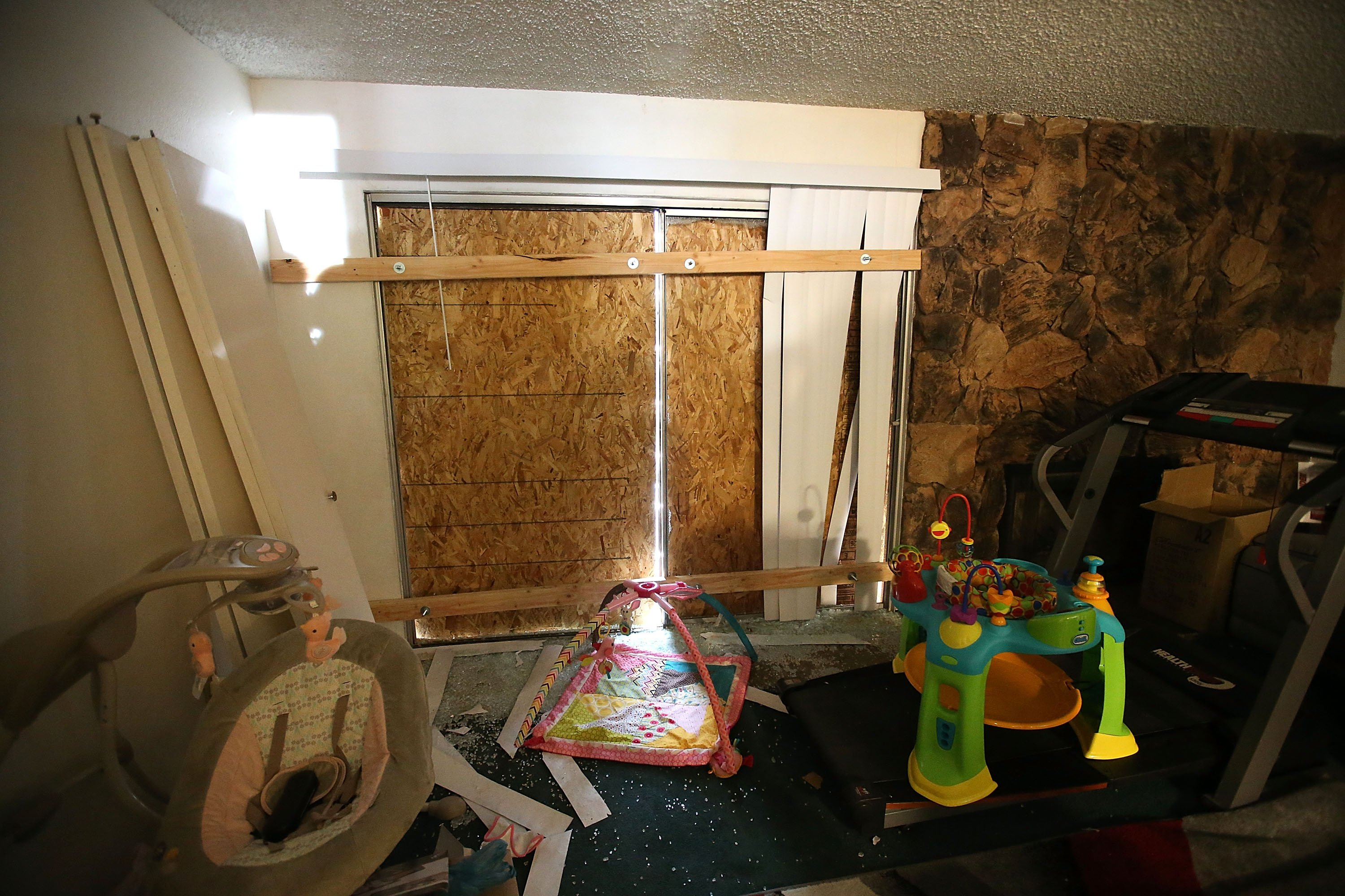 Boards block the windows inside the home of shooting suspect Syed Farook in San Bernardino, CA on Dec. 4, 2015.
