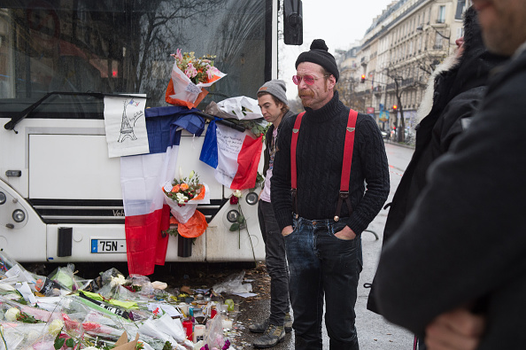 Eagles of Death Metal frontman Jesse Hughes and drummer Julian Dorio visit a memorial that pays homage to the victims of the terrorist attacks at Le Bataclan on December 8, 2015 in Paris, France