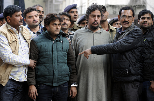 Suspected al-Qaeda terrorists Maulana Abdul Rehman, right, and Zafar Masood, left, in police custody on Dec. 17, 2015, in New Delhi