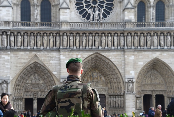 A French soldier patrols next to the Notre-Dame cathedral in Paris on December 24, 2015 as part of security measures set following the Nov. 13 Paris terror attacks.