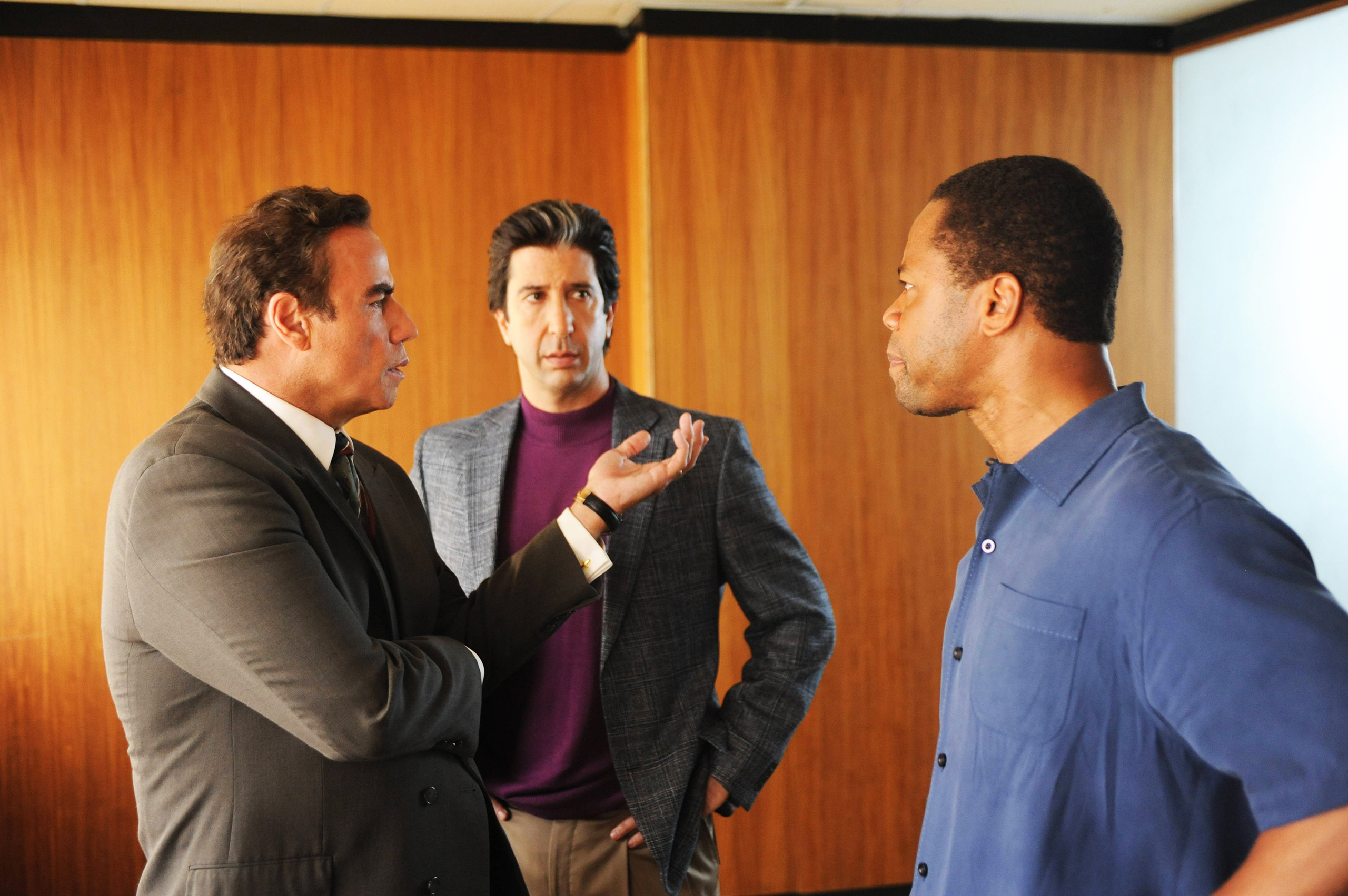 Simpson(Gooding, right) meets with trusted members of his legal  Dream Team (Travolta, left, and Schwimmer)