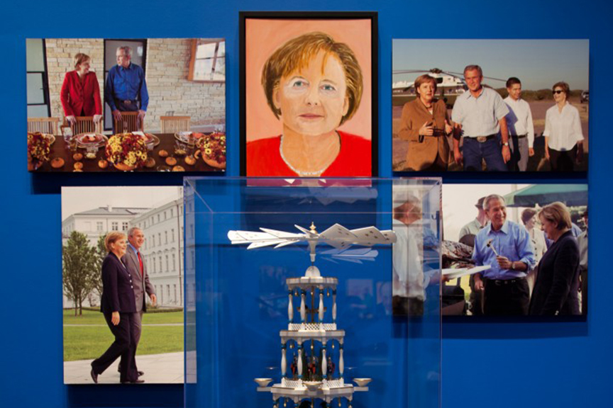 A painting of Angela Merkel by George W. Bush is displayed in the exhibit 'The Art of Leadership: A President's Personal Diplomacy' at the George W. Bush Presidential Center.