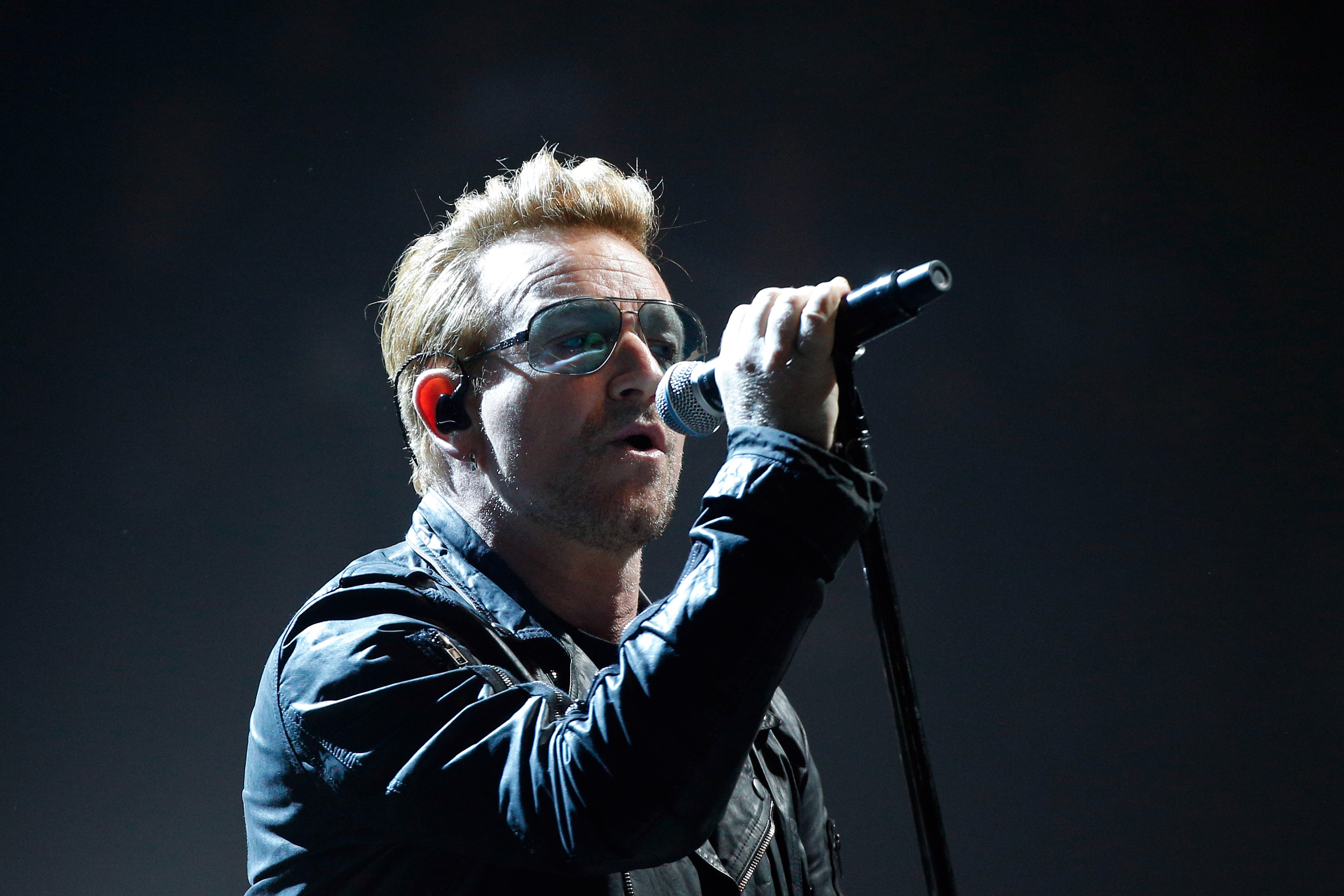 Bono of U2 performs on stage during a concert, in Paris, Dec. 6, 2015