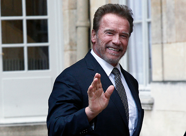 Former California governor and US actor Arnold Schwarzenegger arrives at the Hotel Matignon prior to attend a meeting with French Prime minister Manuel Valls on December 08, 2015 in Paris, France.