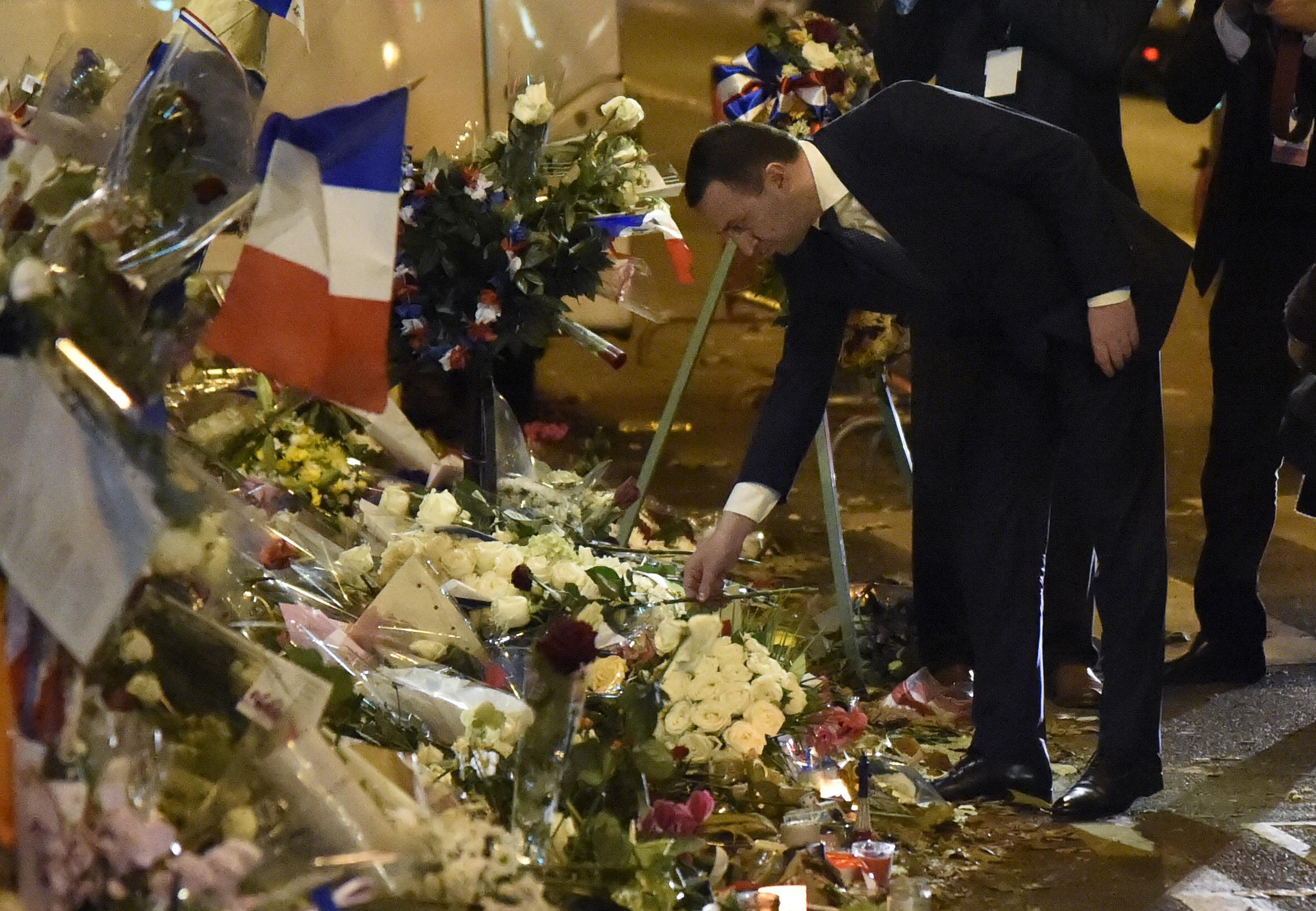 Georgia's Prime Minister Irakli Garibashvili pays tribute to the victims of the November 13 terrorist attacks at a makeshift memorial in front of the Bataclan music hall in Paris, on November 30, 2015.