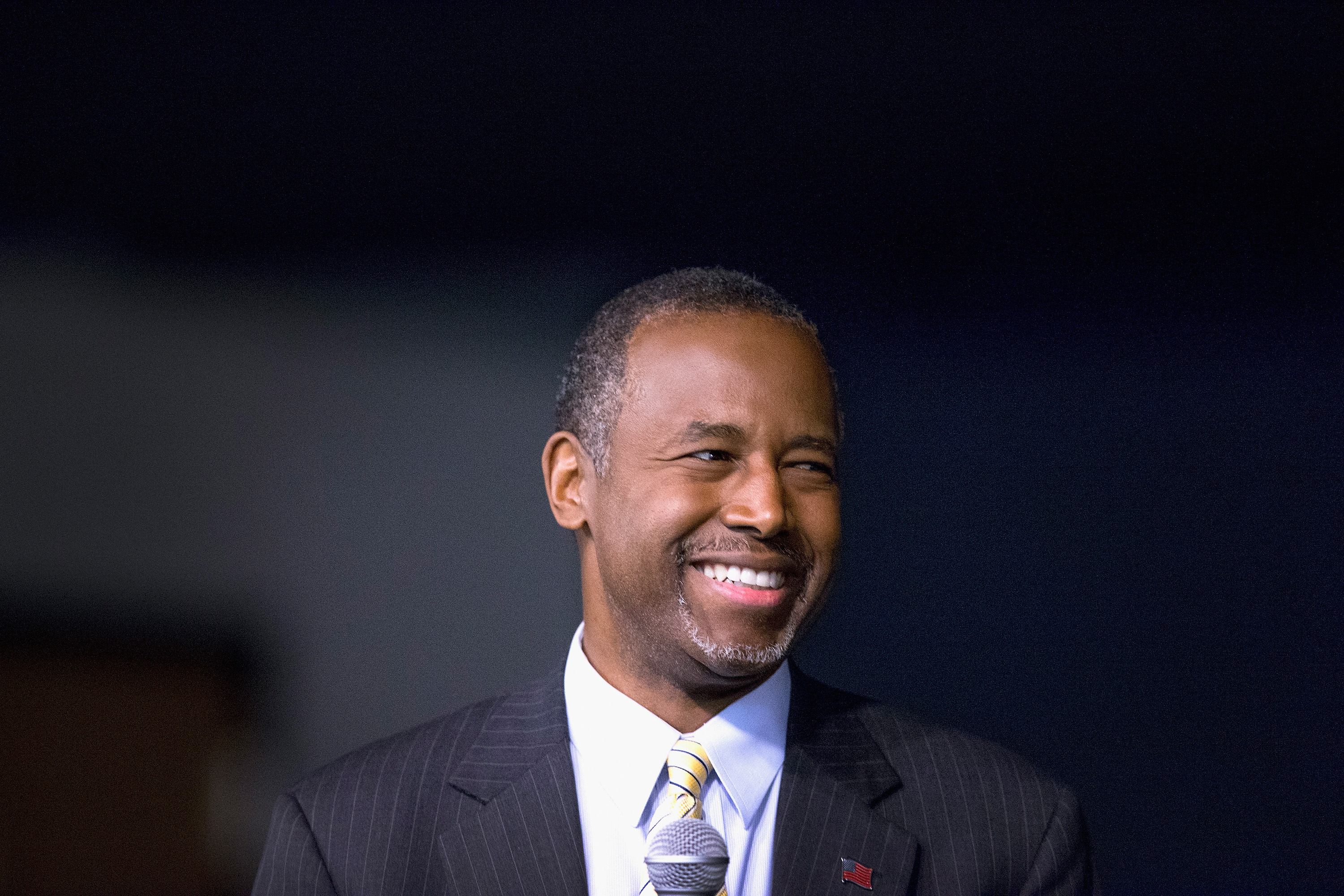 Republican presidential candidate Ben Carson speaks to guests at a barbeque hosted by Jeff Kauffman in Wilton, Iowa on Nov. 22, 2015.