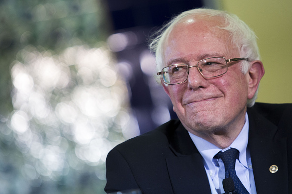 Senator Bernie Sanders, an independent from Vermont and 2016 Democratic presidential candidate, smiles during an interfaith roundtable in Washington, D.C., U.S., on Wednesday, Dec. 16, 2015.