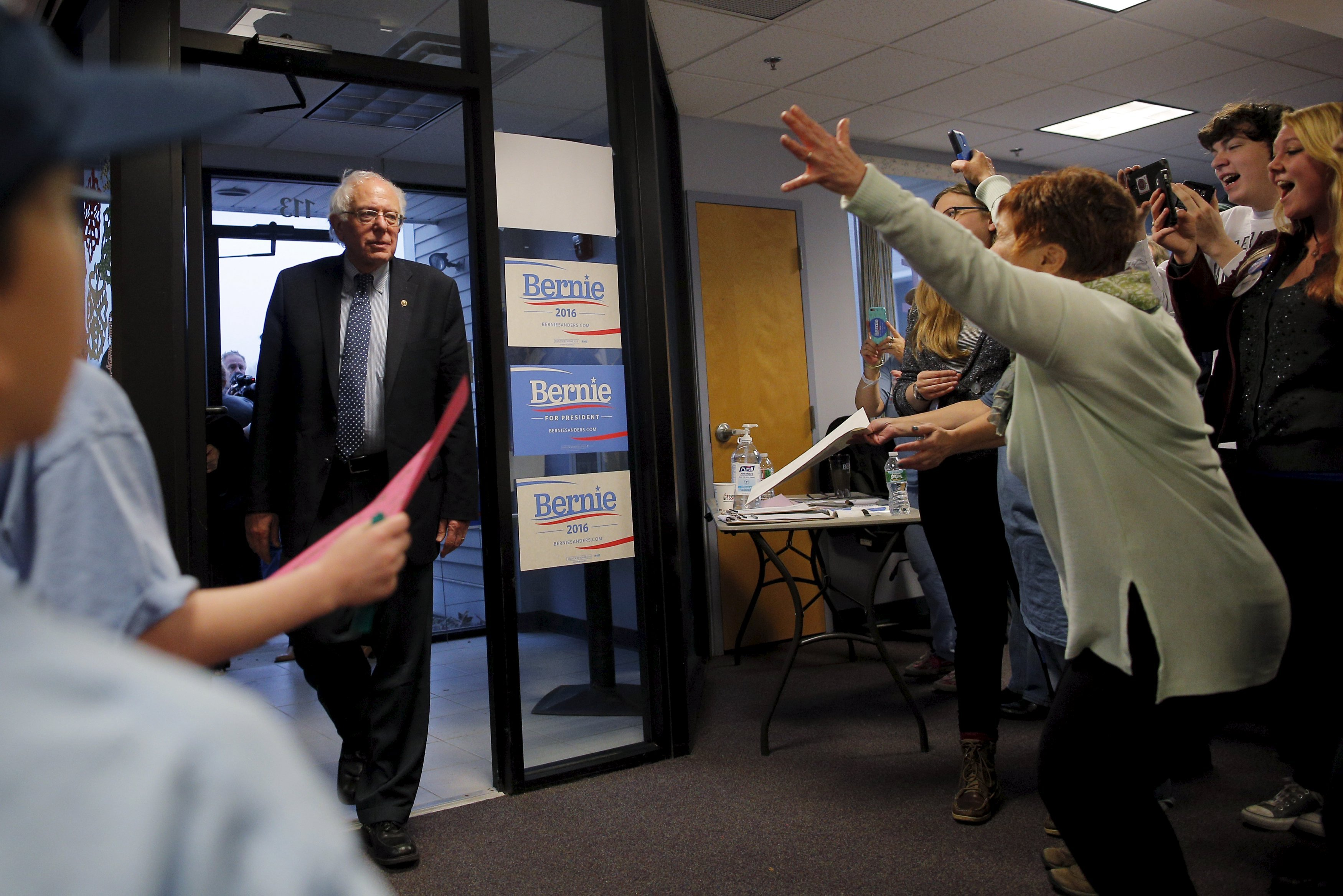 Supporters welcome U.S. Democratic presidential candidate and U.S. Senator Bernie Sanders as they open a new regional campaign field office in Salem, New Hampshire Dec. 14, 2015.
