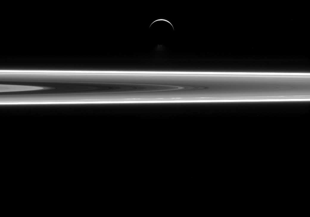 Saturn's icy moon Enceladus and a small stretch of Saturn's rings, as seen by the Cassini spacecraft on July 29, 2015.