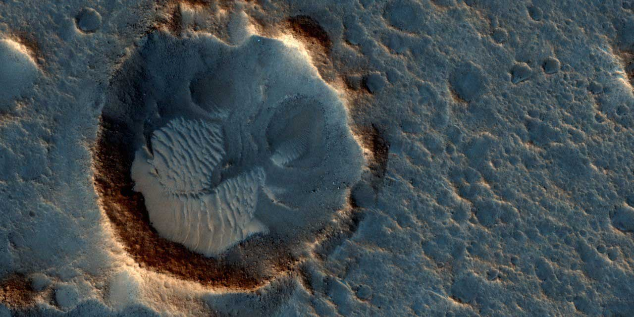 "This image taken by NASA's Mars Reconnaissance Orbiter  in May 2015 shows Acidalia Planitia, a location on the red planet that was recreated in the film ""The Martian."""