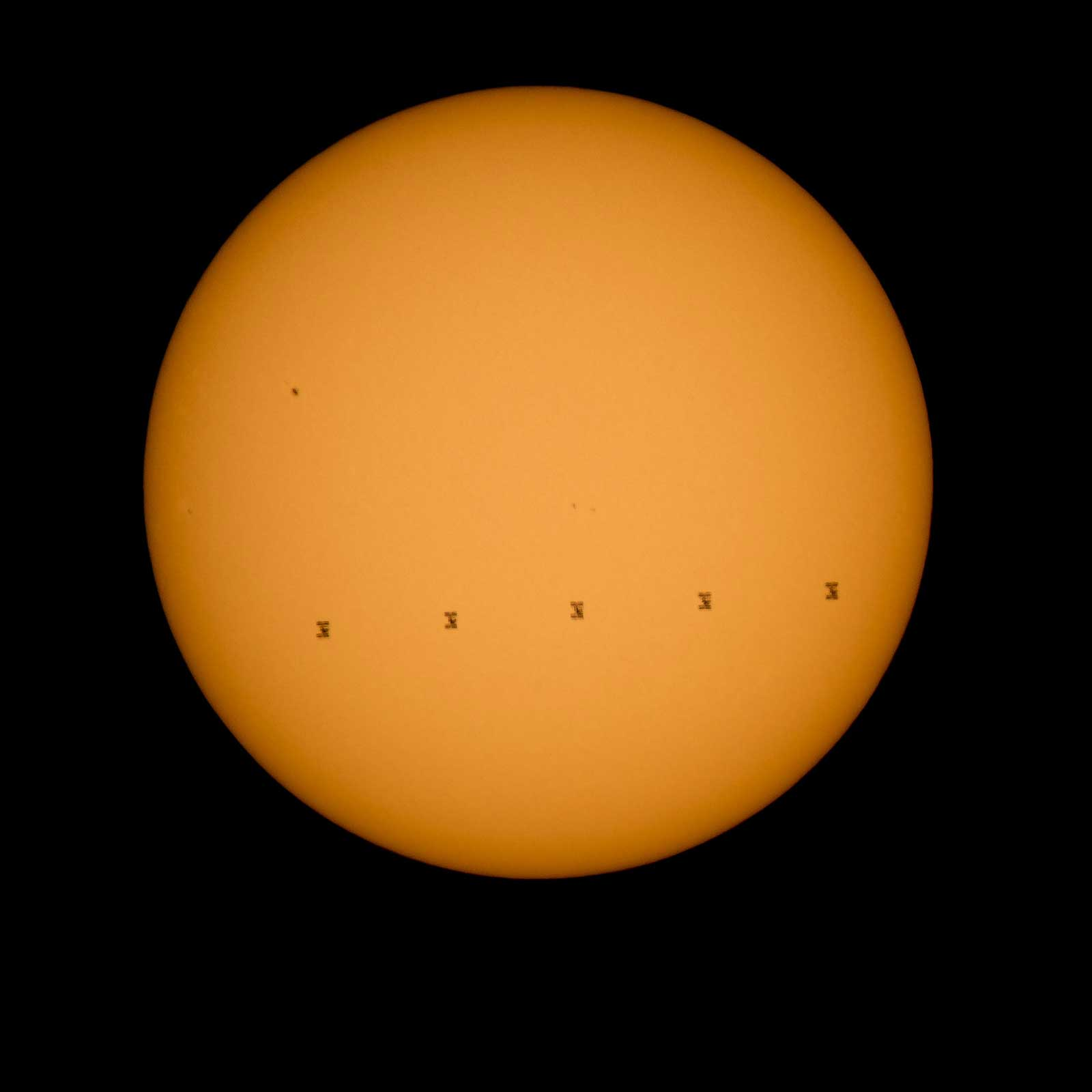 This composite image made from five frames shows the International Space Station, with a crew of nine onboard, in silhouette as it transits the sun at roughly five miles per second, on Sept. 6, 2015.