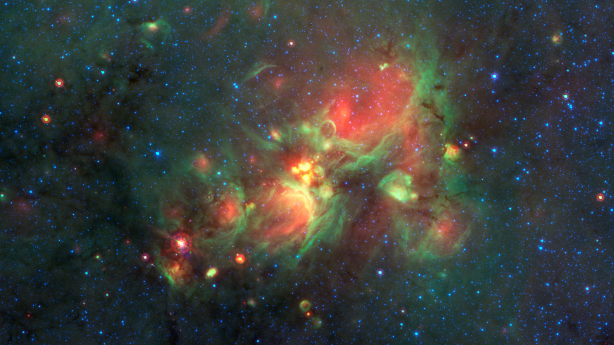 "Volunteers using the web-based Milky Way Project brought star-forming features nicknamed ""yellowballs"" to the attention of researchers, who later showed that they are a phase of massive star formation. The yellow balls -- which are several hundred to thousands times the size of our solar system -- are pictured here in the center of this image of the W33 Star forming region taken by NASA's Spitzer Space Telescope, released on Jan. 27, 2015."