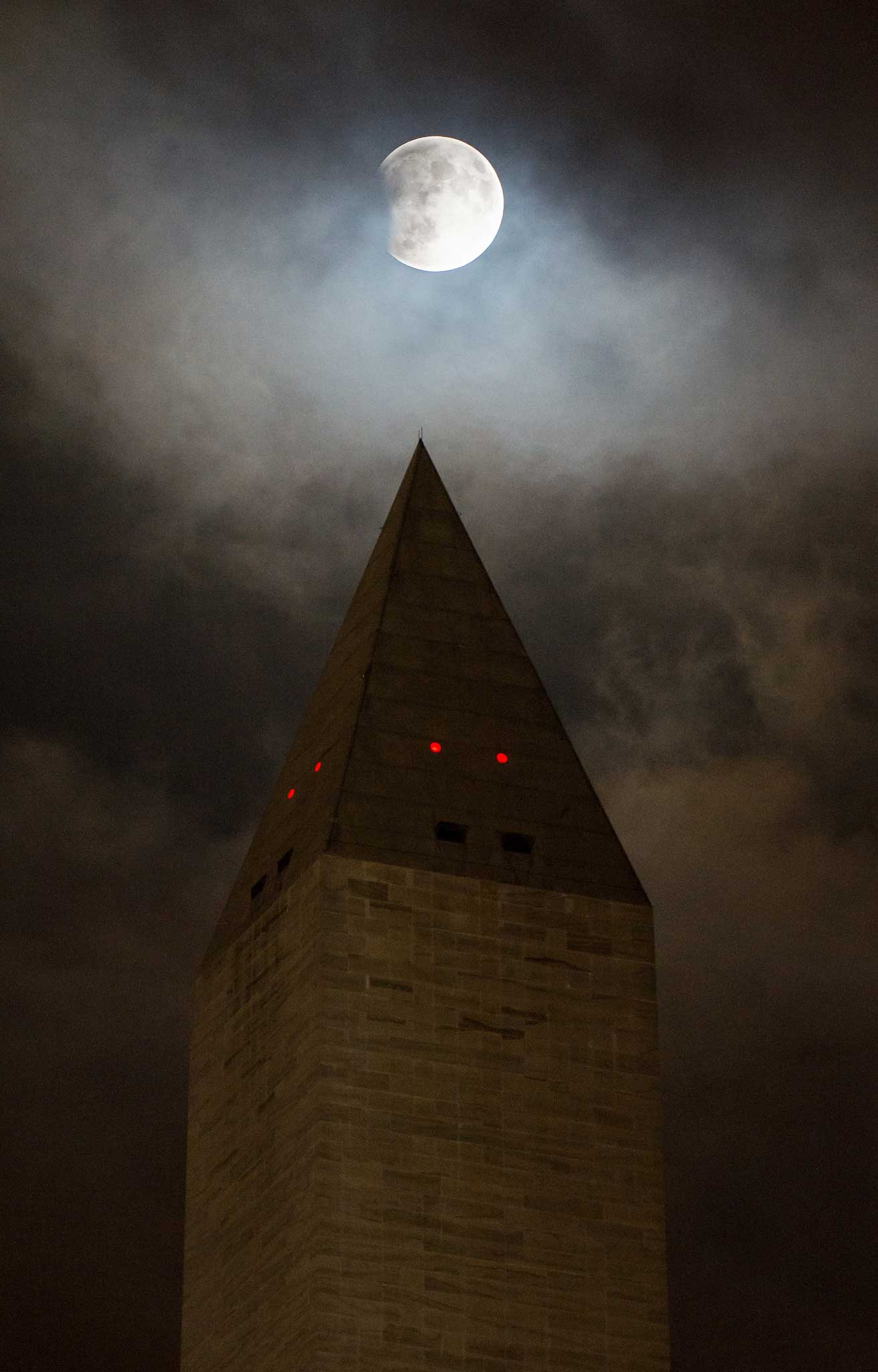 The supermoon, which occurs when the moon is full, with the closest approach to Earth on its elliptical orbit, above the Washington Monument on Sept. 27 2015. Making the phenomenon even more dramatic: a total lunar eclipse also occurred that evening.