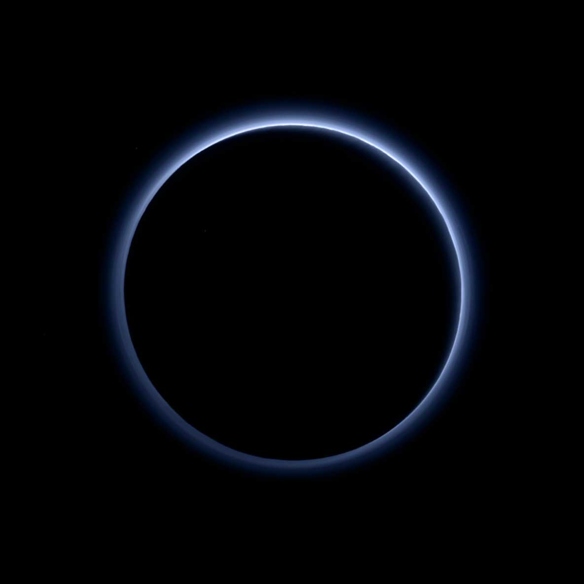 Pluto's haze layer shows its blue color in this picture taken by the New Horizons spacecraft on Oct. 8, 2015 after it passed the dwarf planet. The high-altitude haze is thought to be similar to that seen at Saturn's moon Titan. The source of both hazes likely involves sunlight-initiated chemical reactions of nitrogen and methane, leading to relatively small, soot-like particles called tholins.